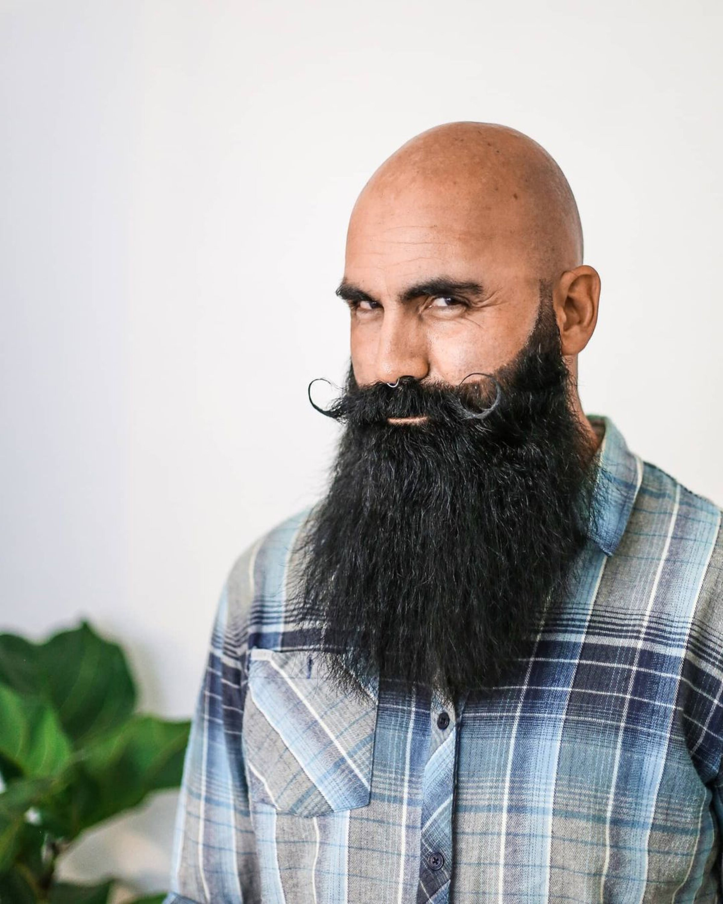 A full beard with a handlebar moustache for bald men.