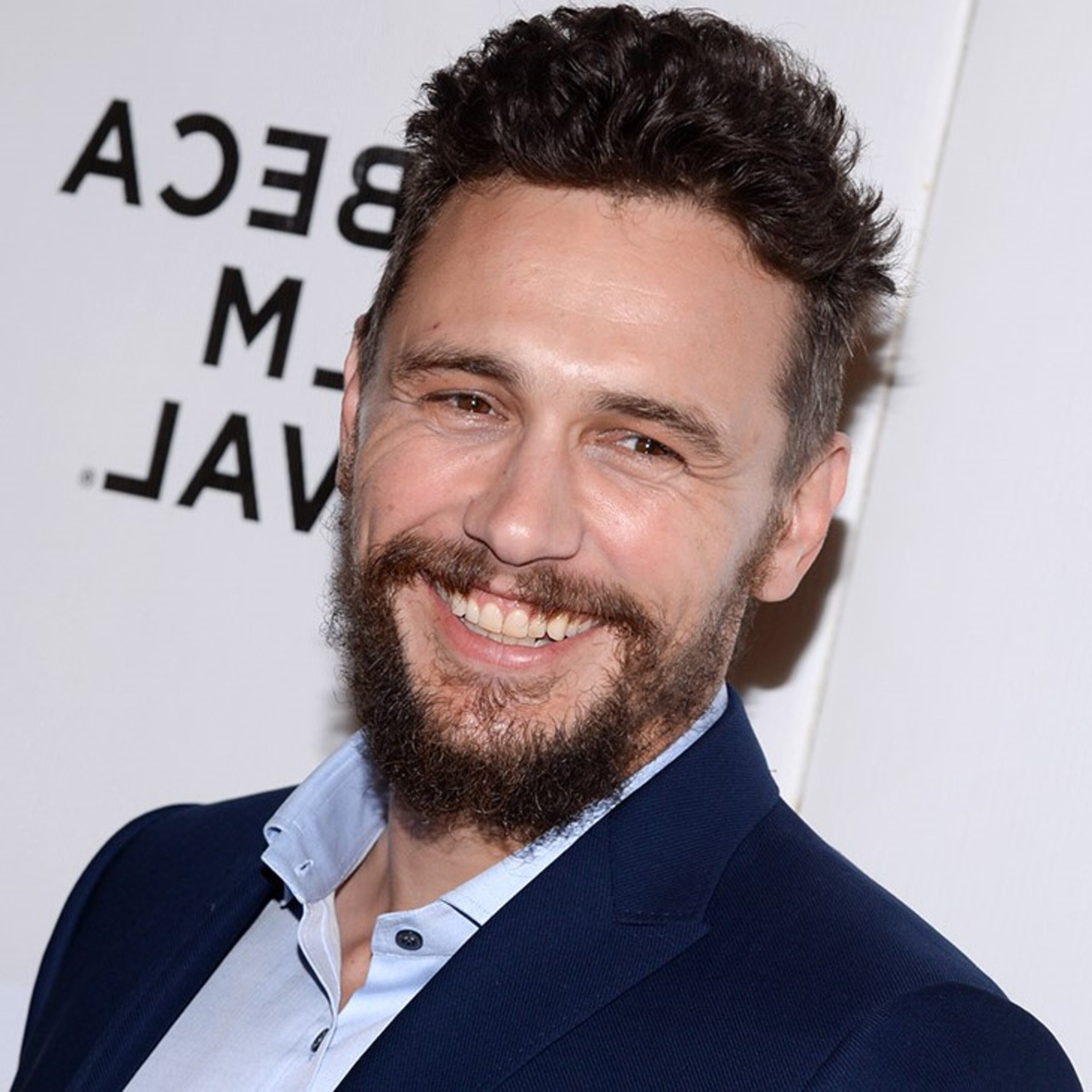 A full beard in the style of James Franco.