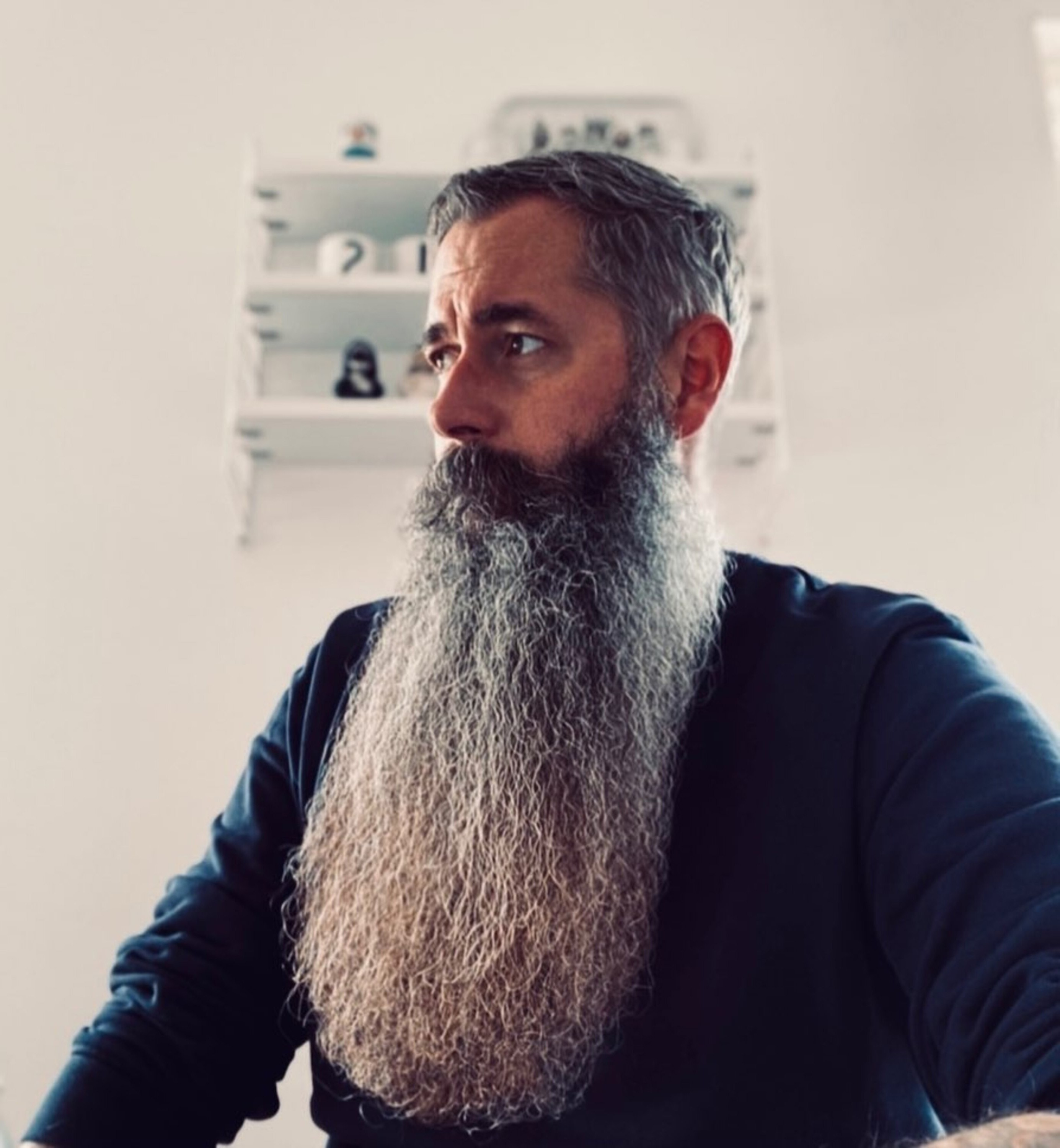 A long full beard for males.
