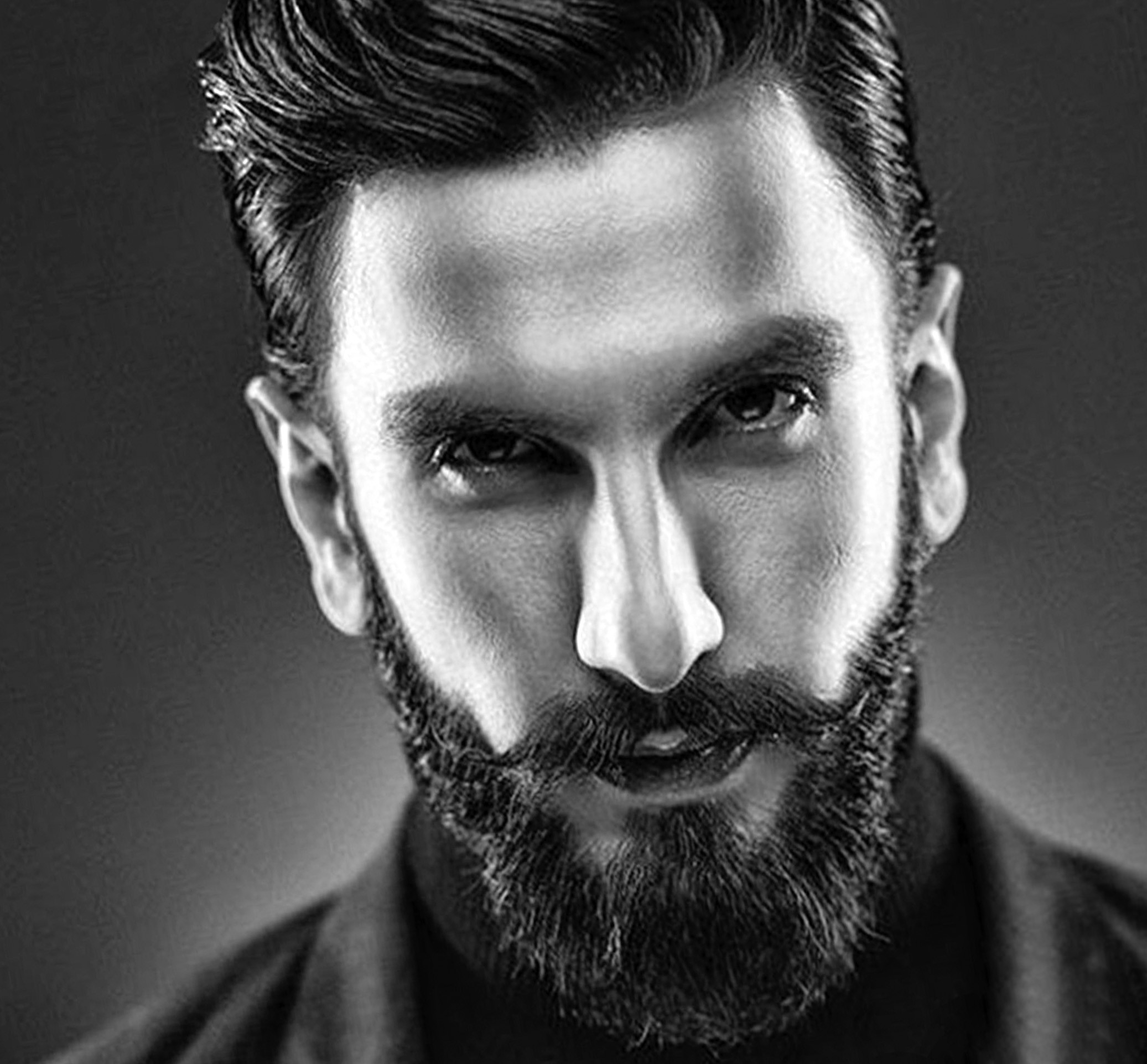 A full beard in the style of Ranveer Singh.