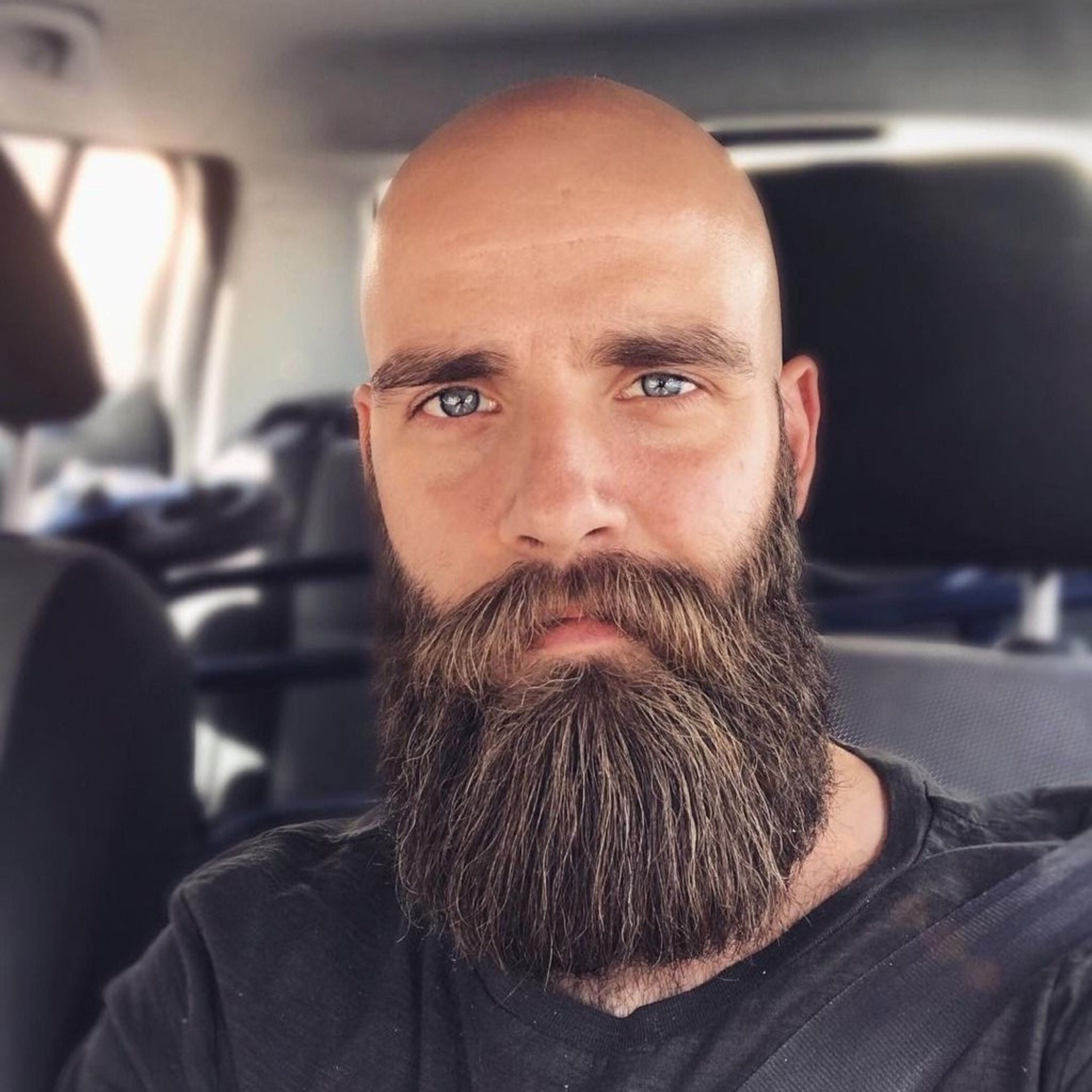 A full beard for men with the shaved haircut.