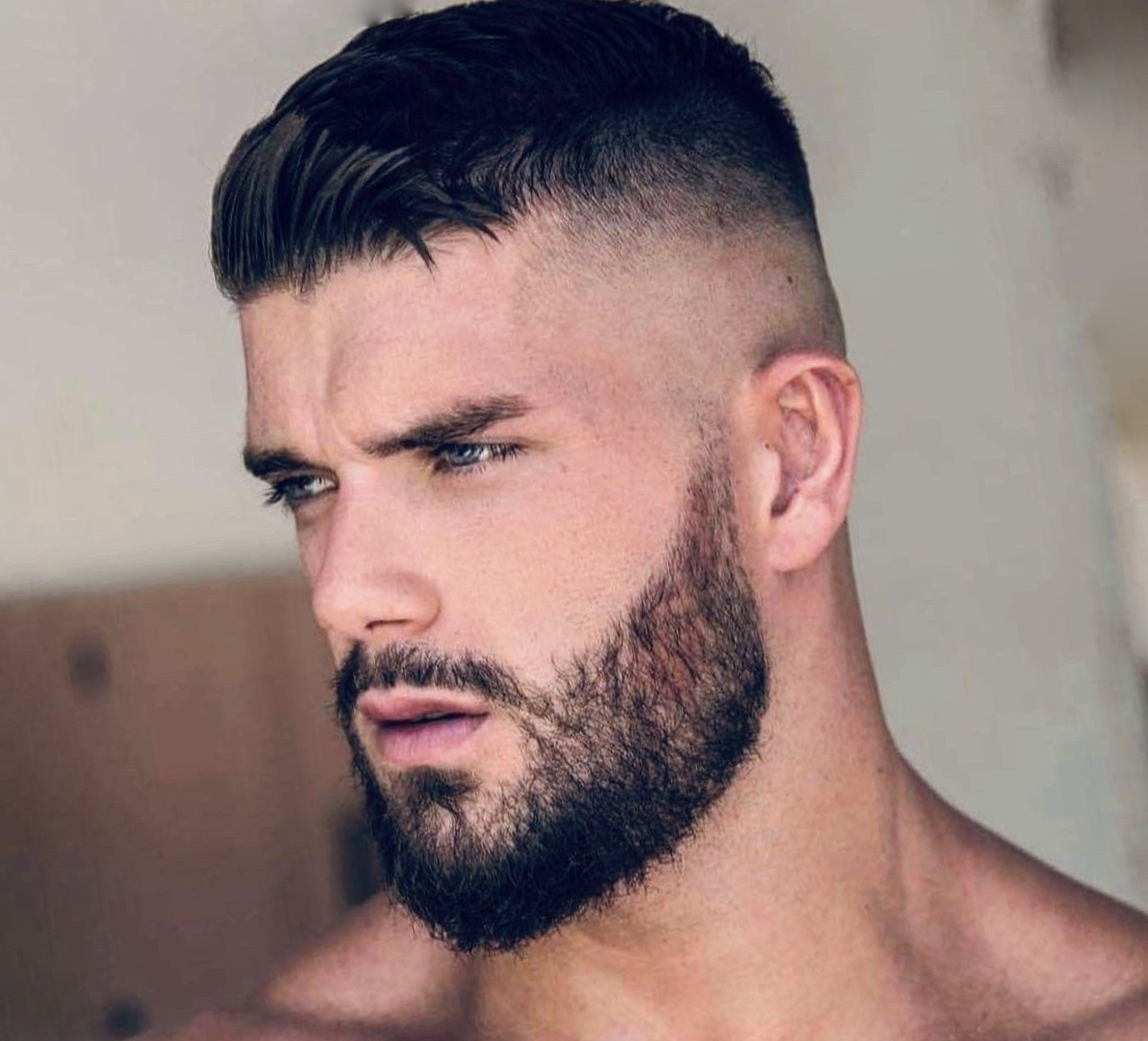 A short beard style for men with short hair.