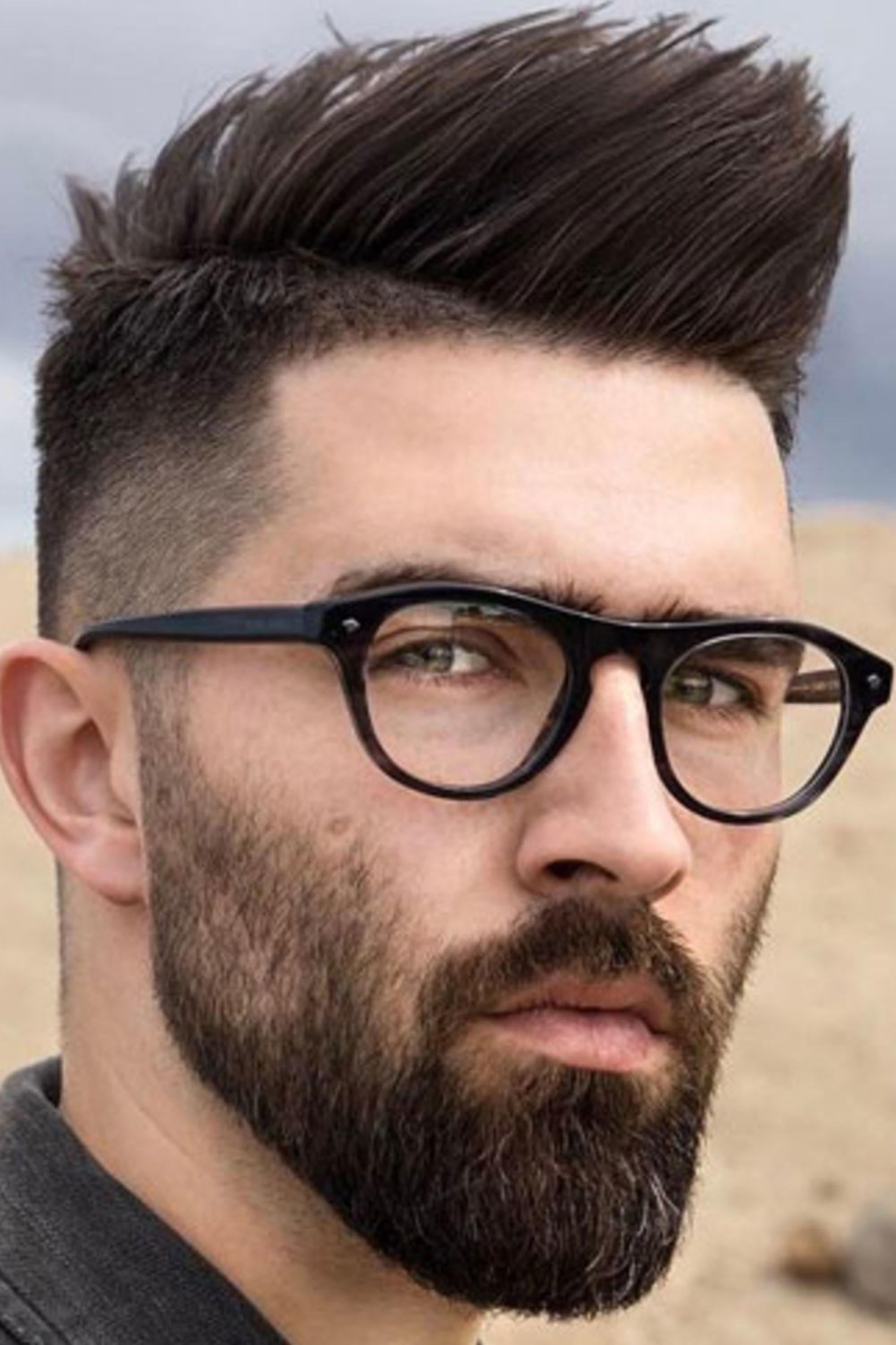 A short and tapered beard for stylish men.