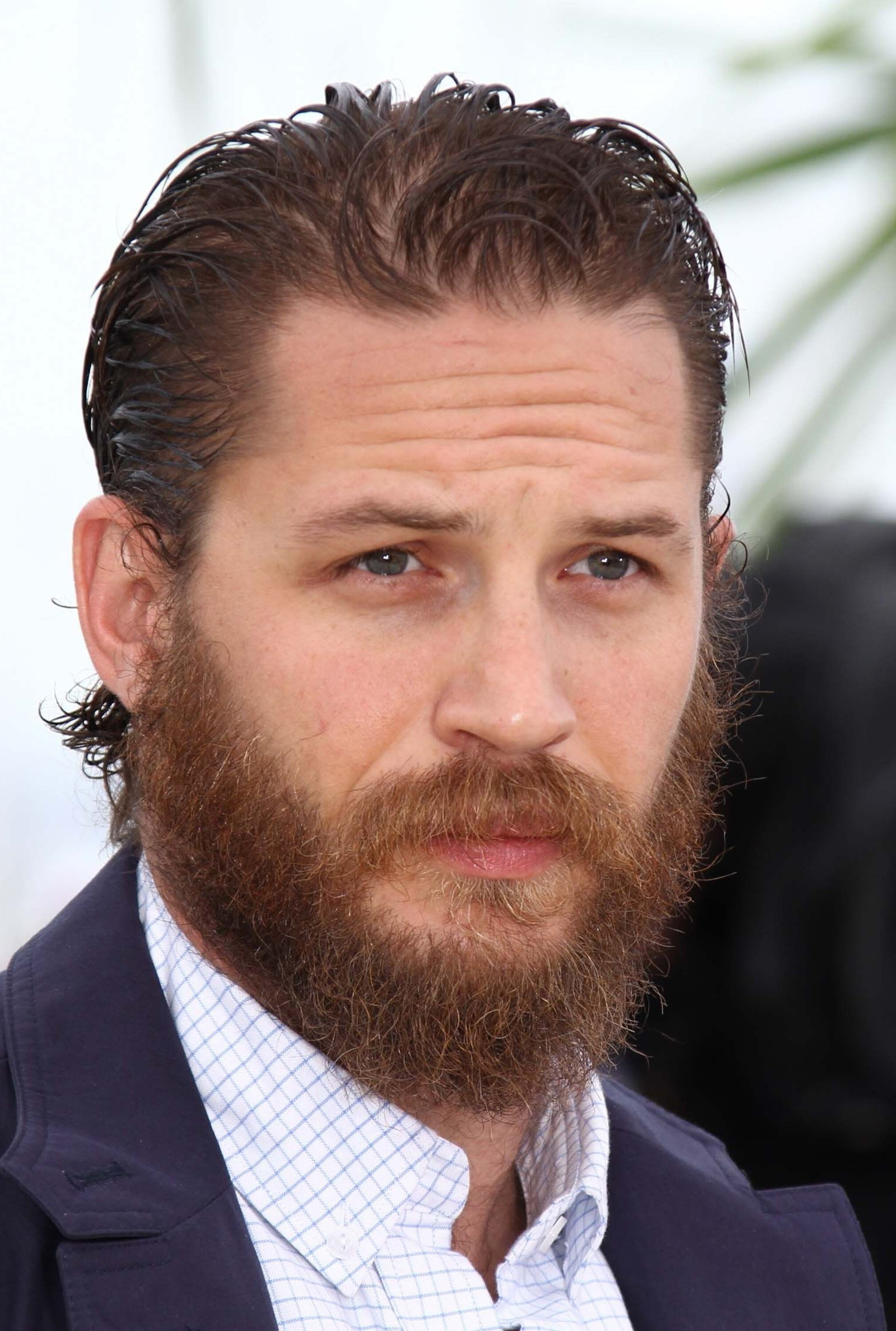 A full beard of Tom Hardy.