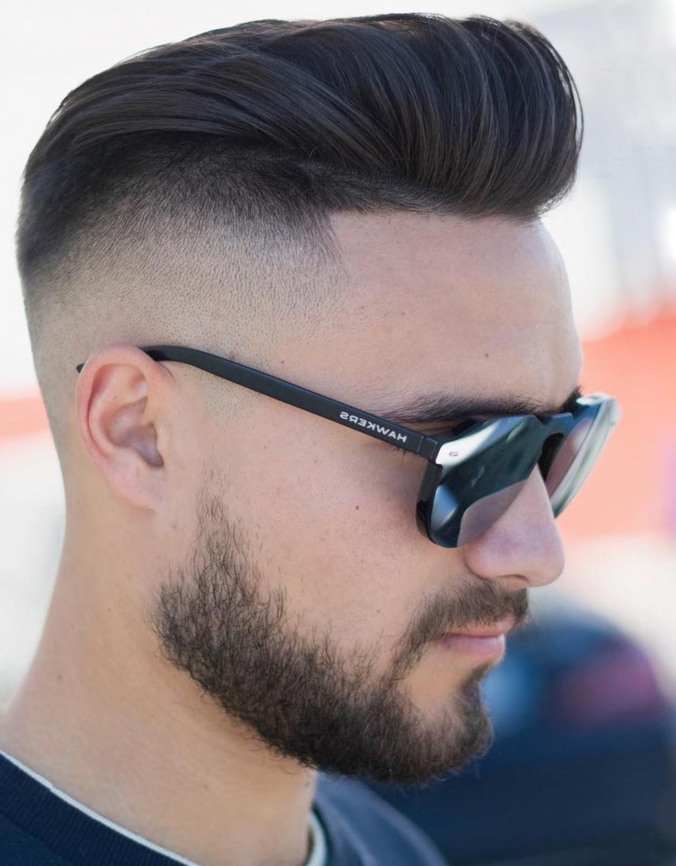 A short beard for men with an undercut.