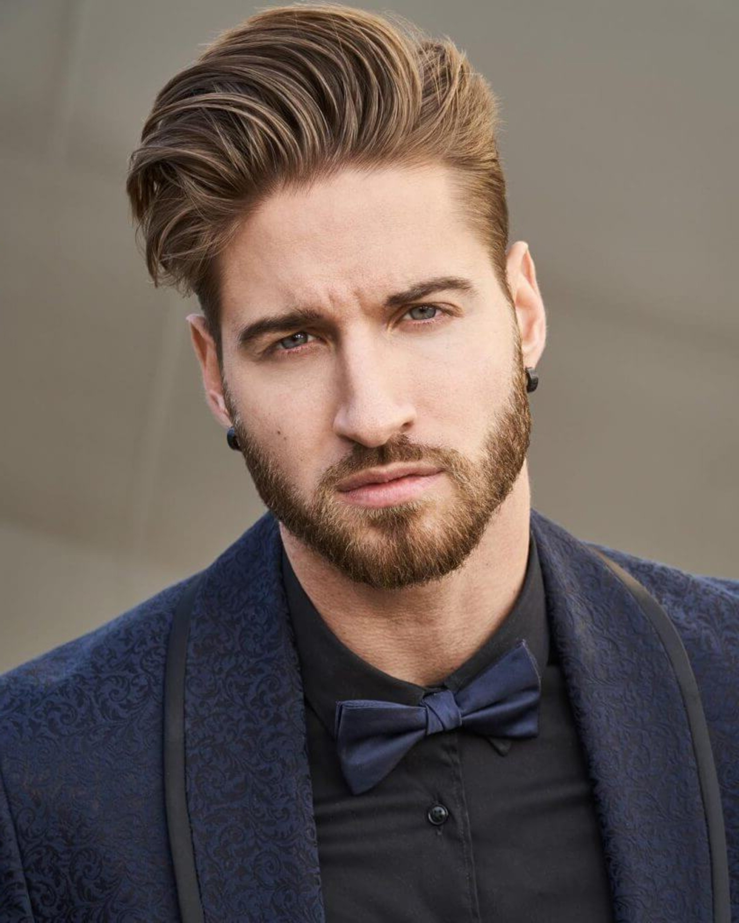 A well-trimmed short beard for elegant guys.