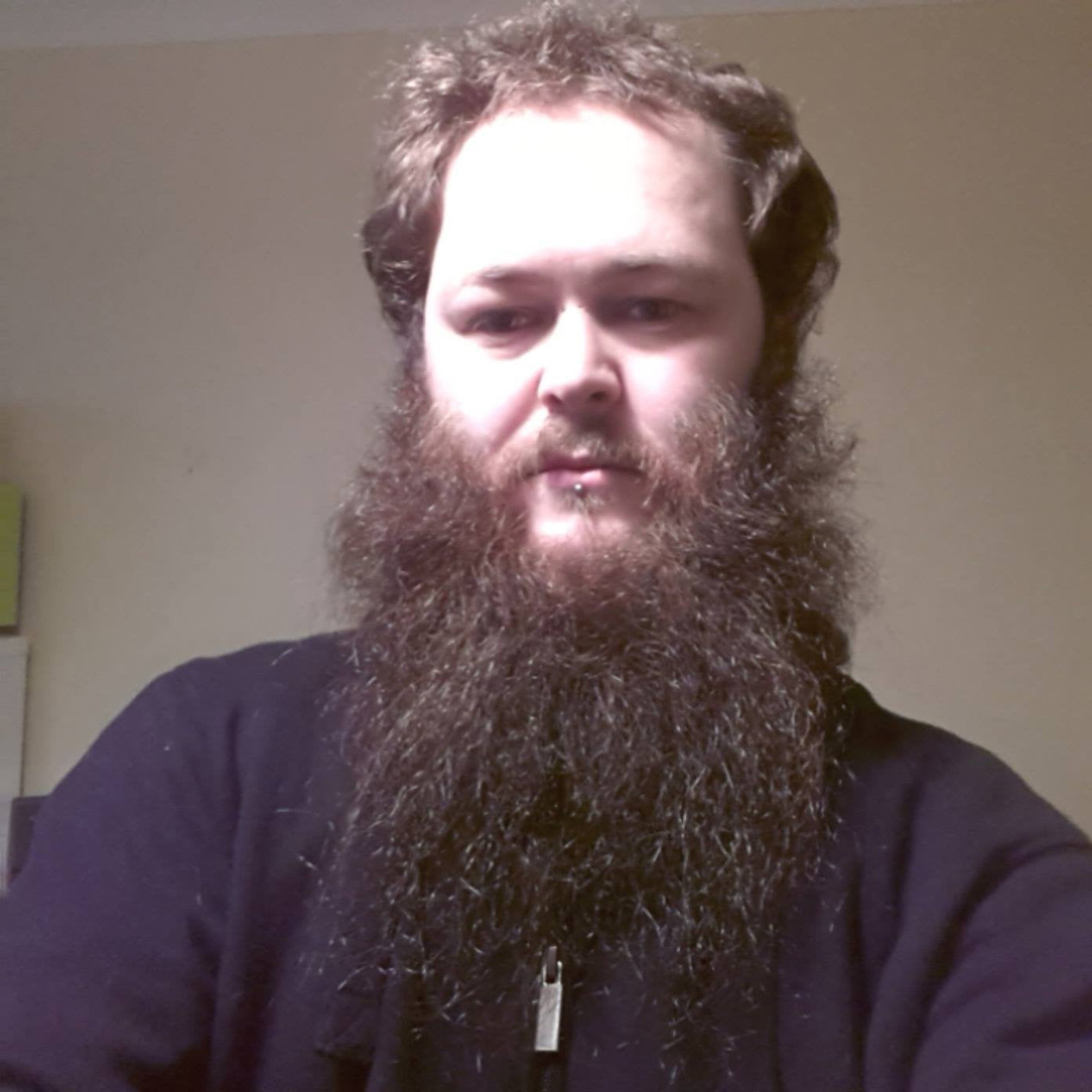 A full untrimmed beard style.