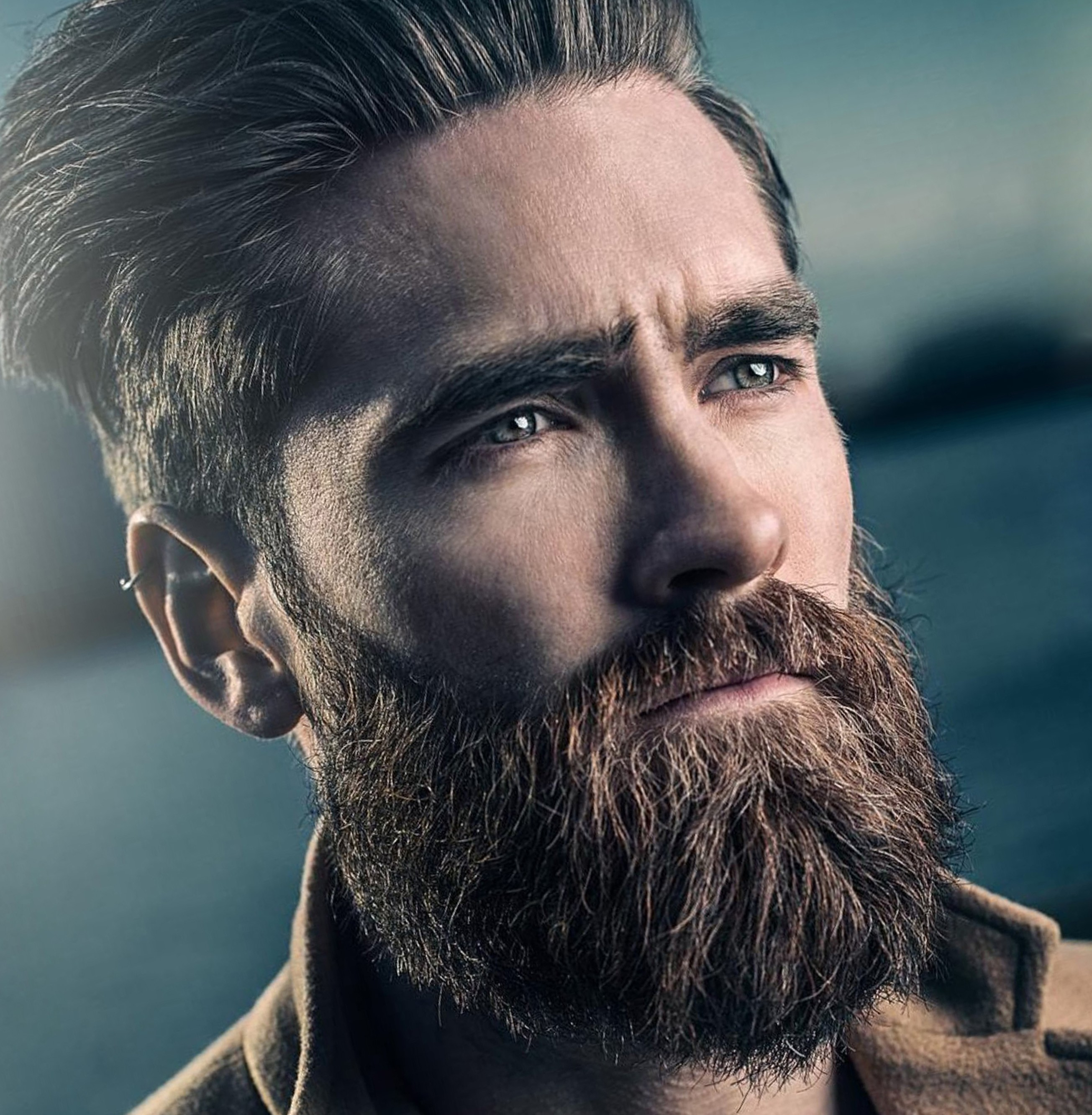 A full beard combined with the high faded style.