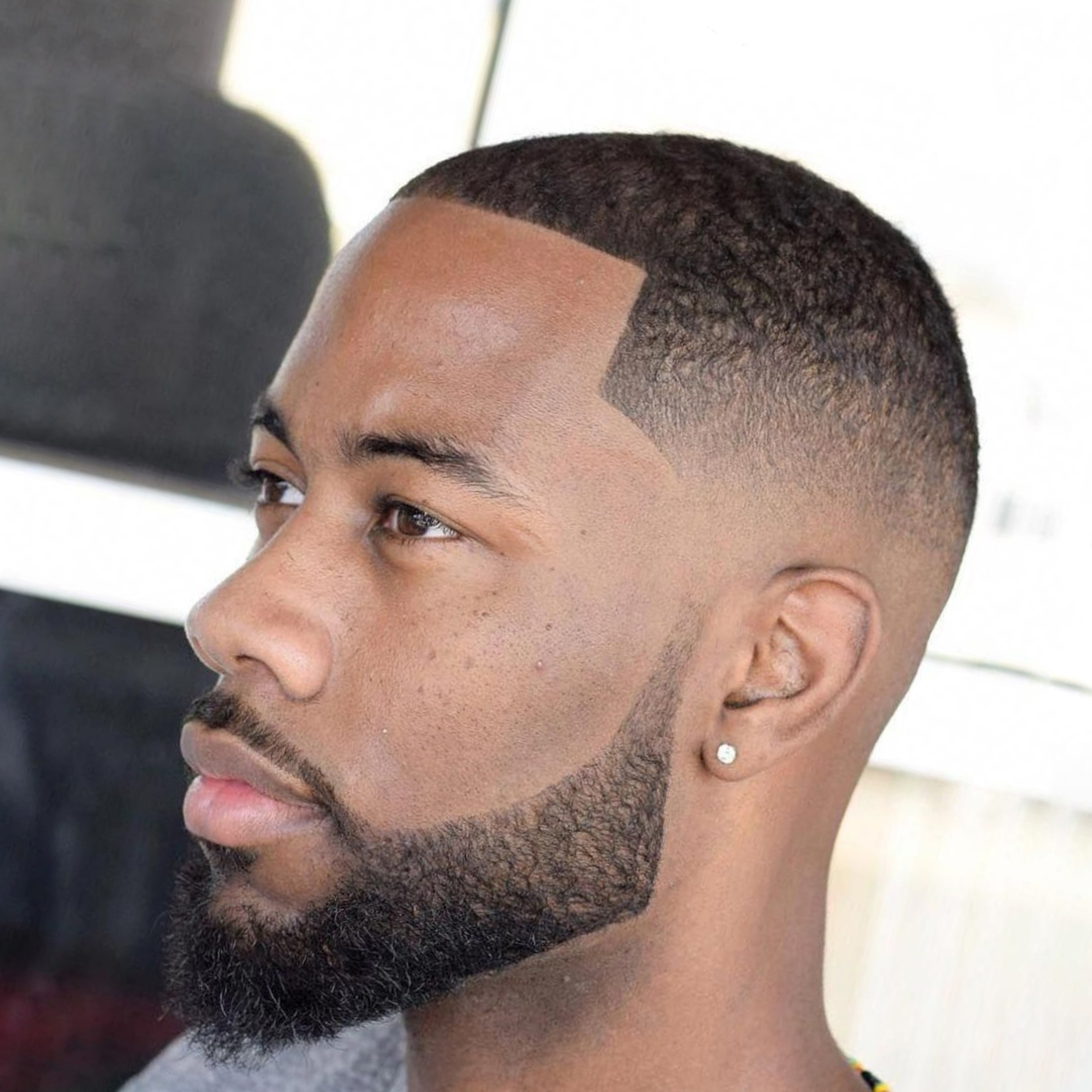 A low beard style for a black man.