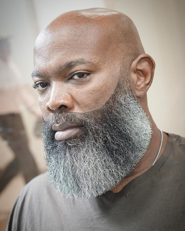 A black man with a salt and pepper beard.