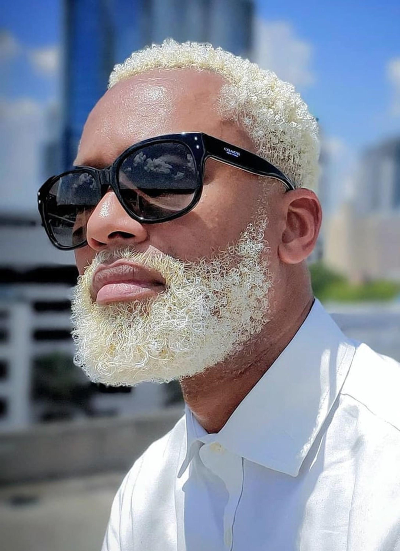 A nice blonde beard style for a black man.