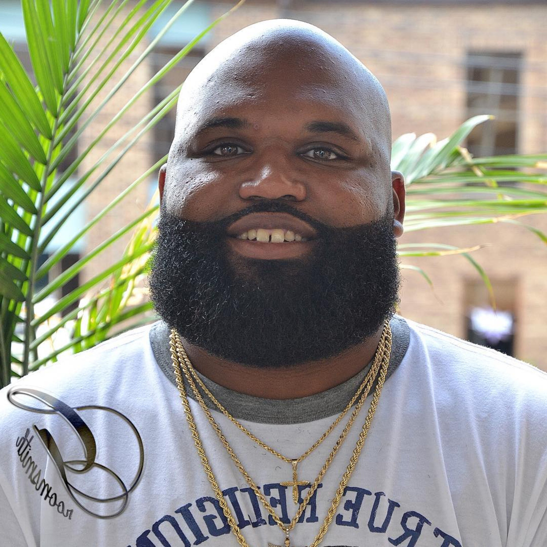 A big black man with a beard.