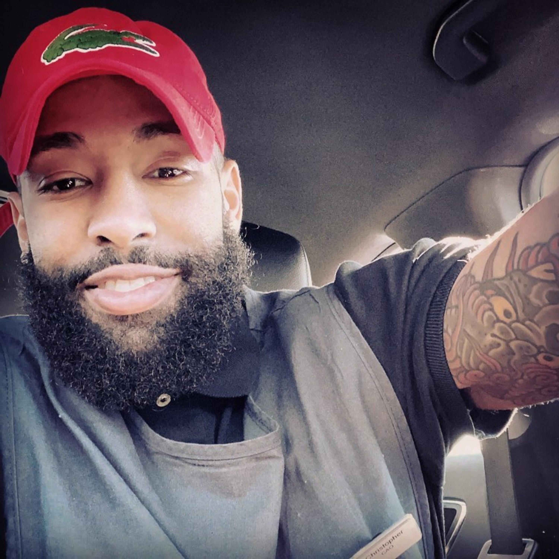 A nice black man with a beard.
