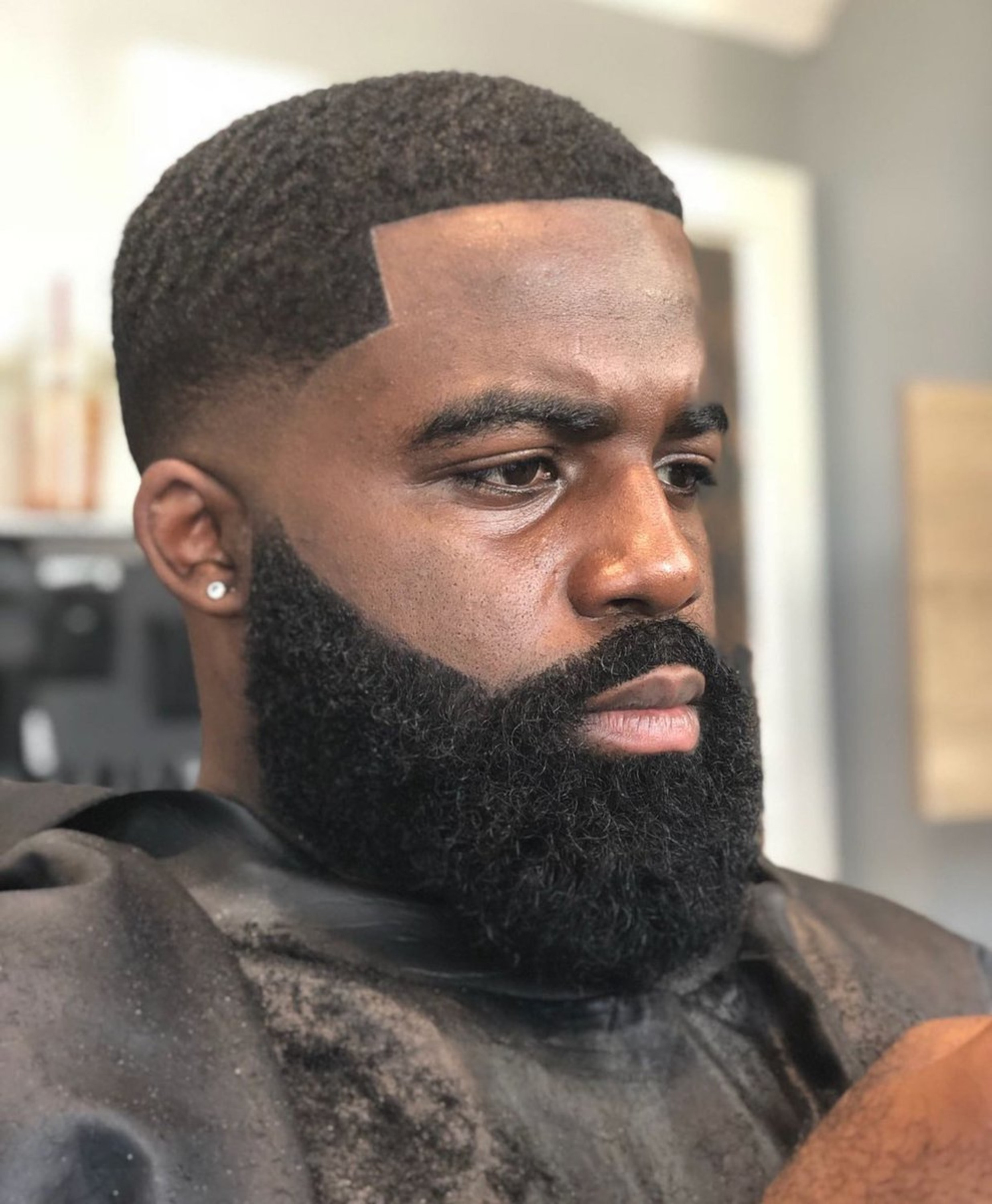 A black man beard in a lace front style.