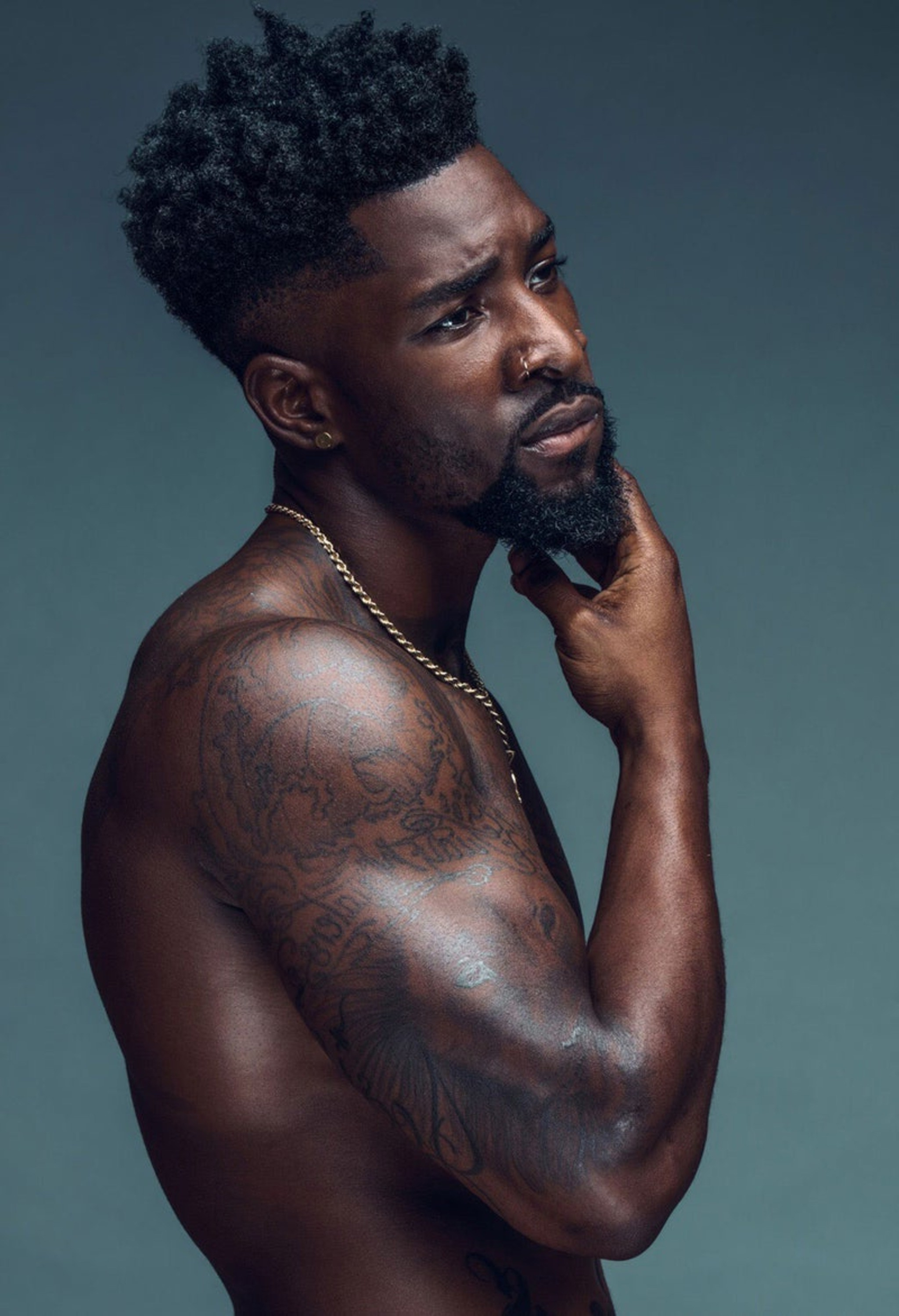 A cool black man with a beard style.
