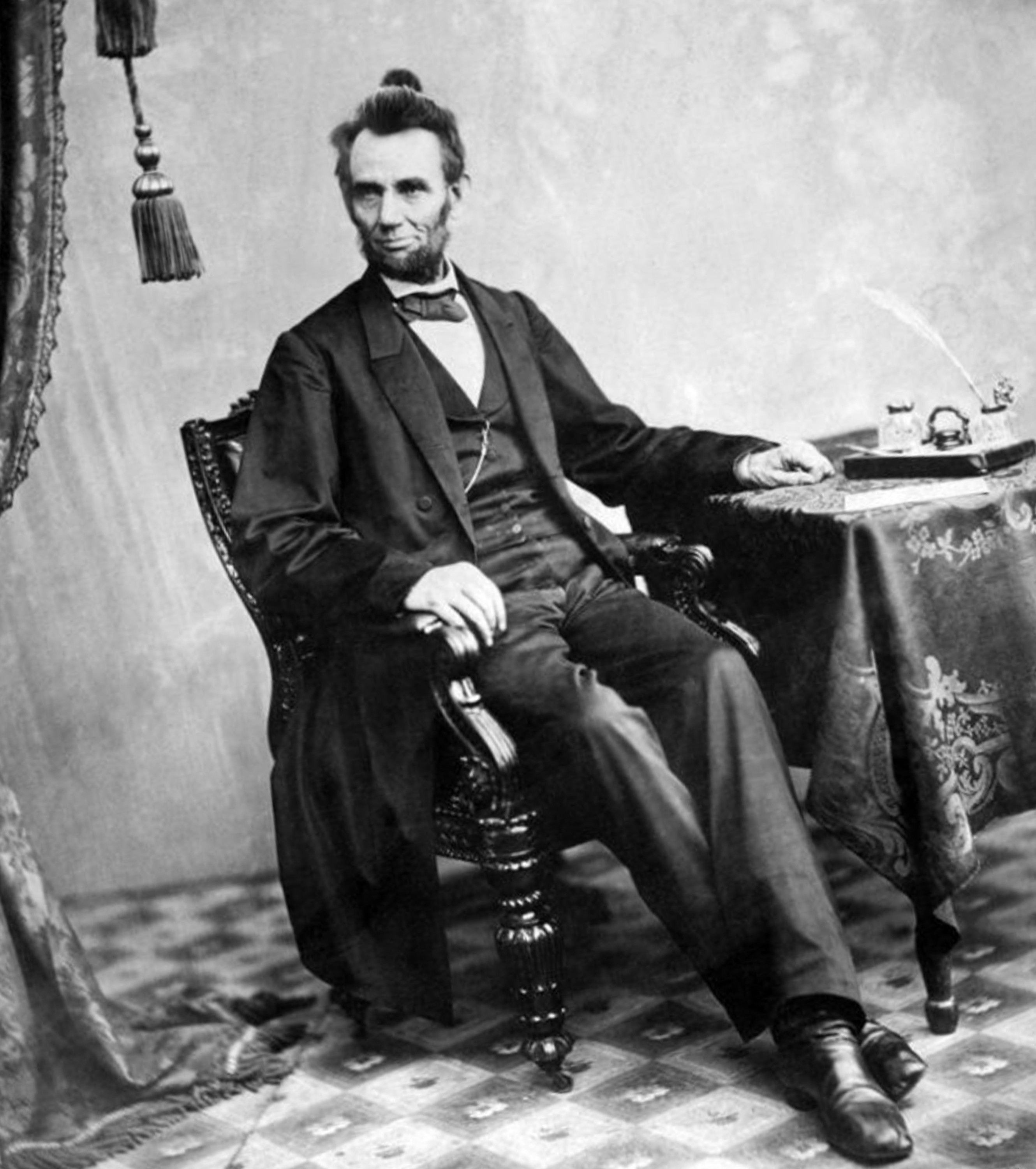 Abraham Lincoln with elegant male bun style.