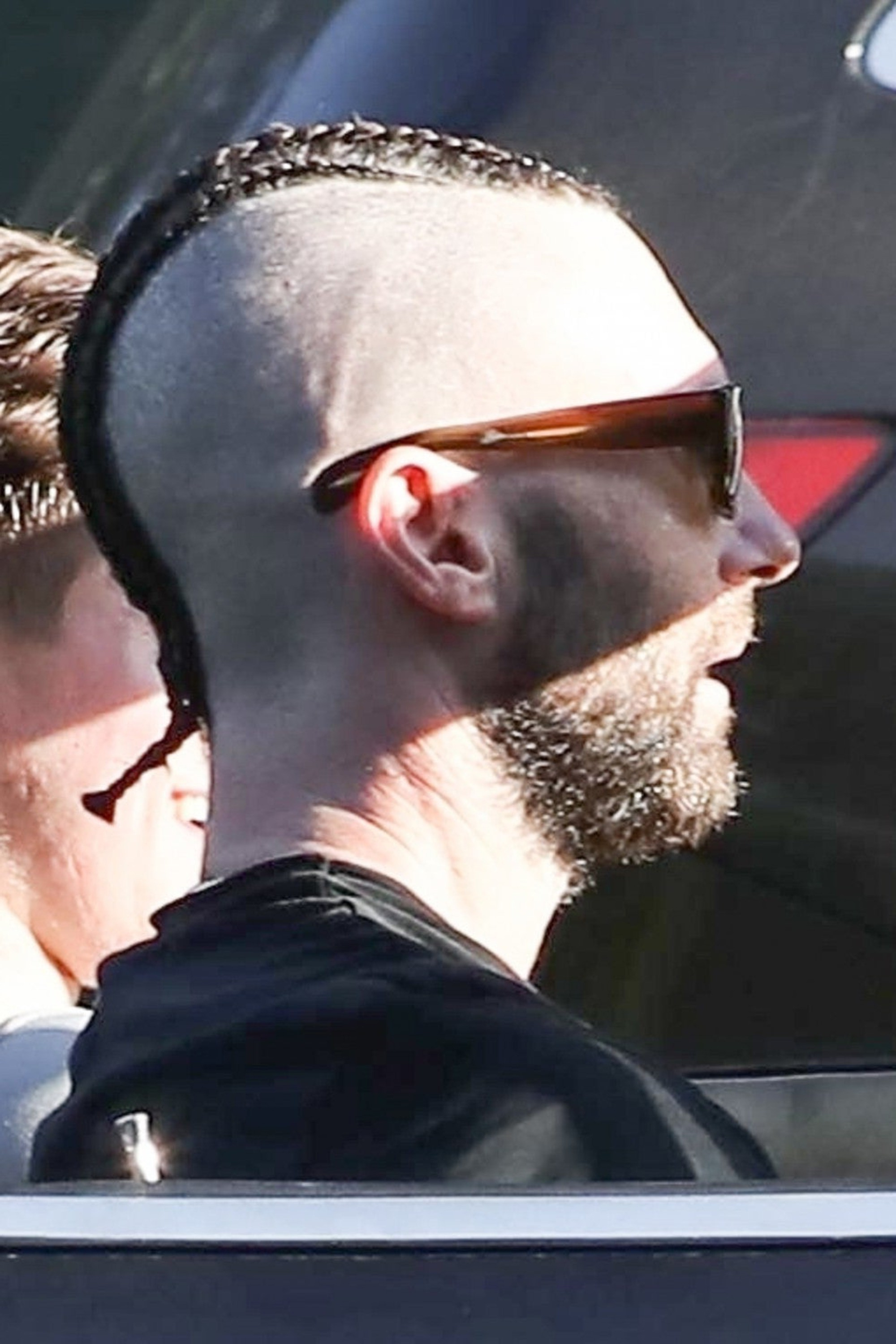 Adam Levine wears a great-looking bun style.