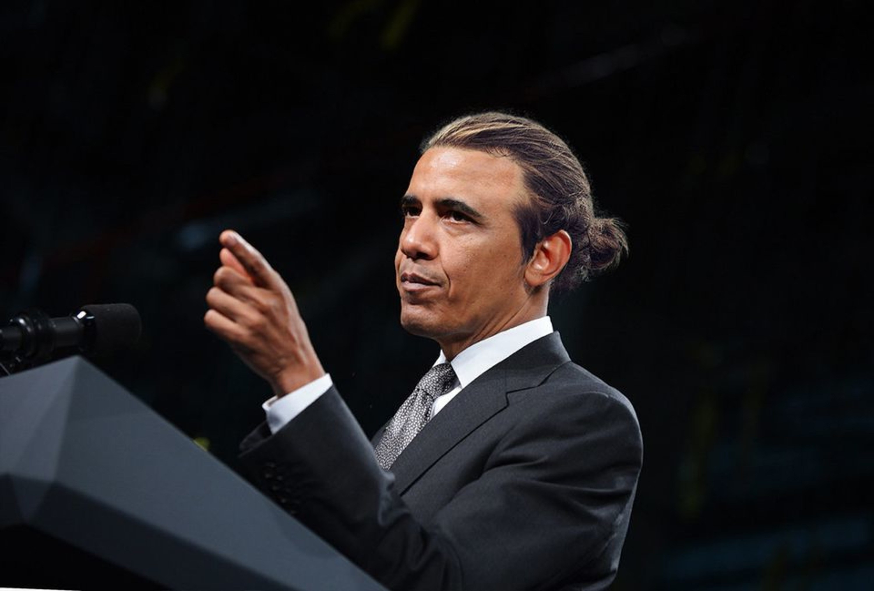 Barack Obama with a casual bun style.