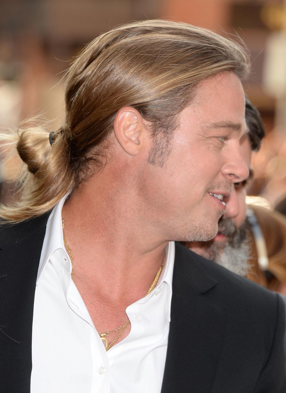 Brad Pitt wearing a fashionable bun style.