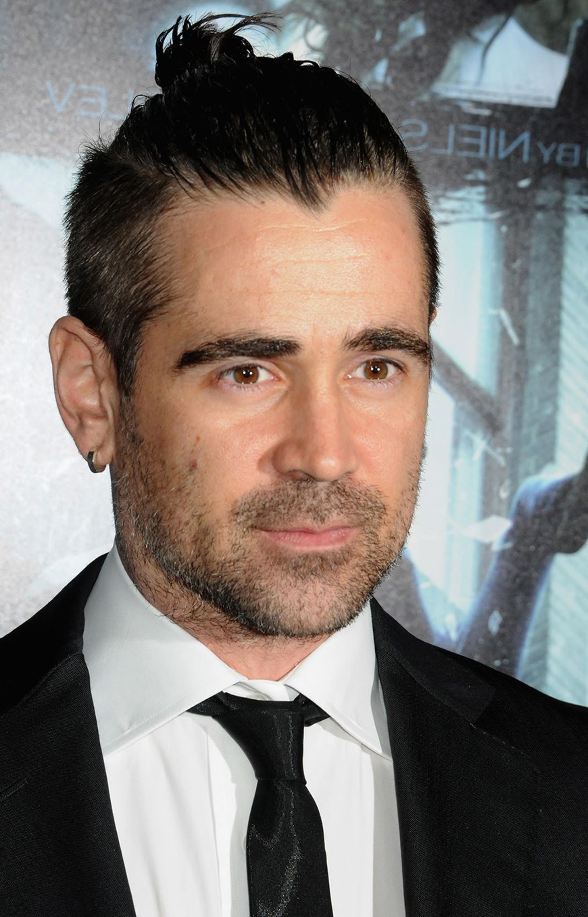 Colin Farrell with a cool bun style.