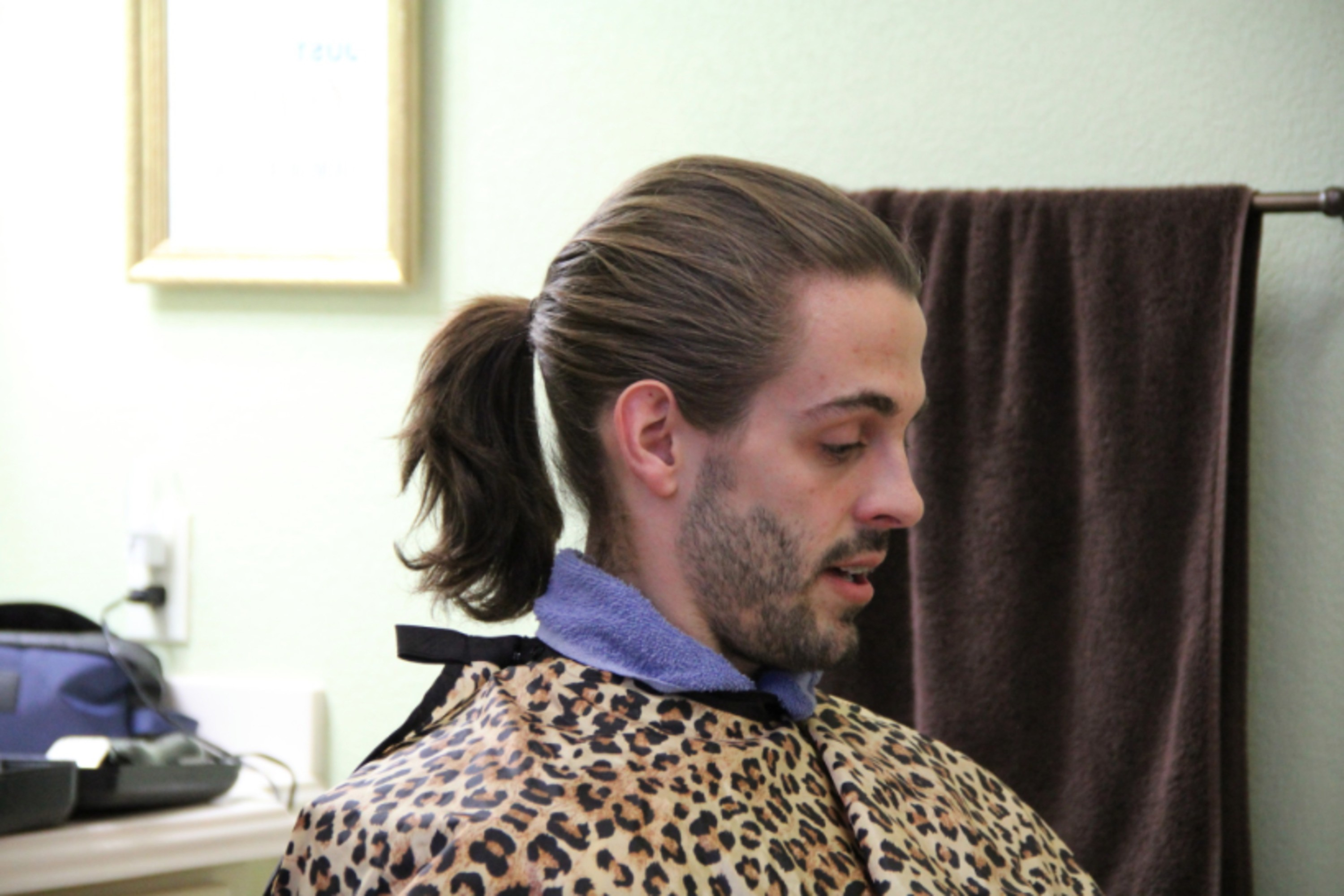 Derick Dillard man style with a bun.