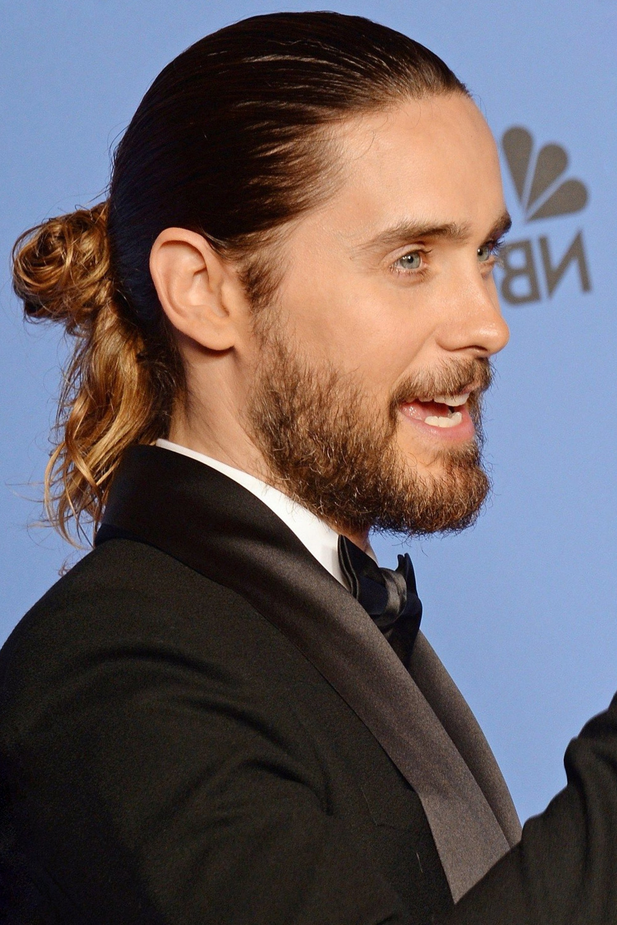 Jared Leto super stylish look with a bun.
