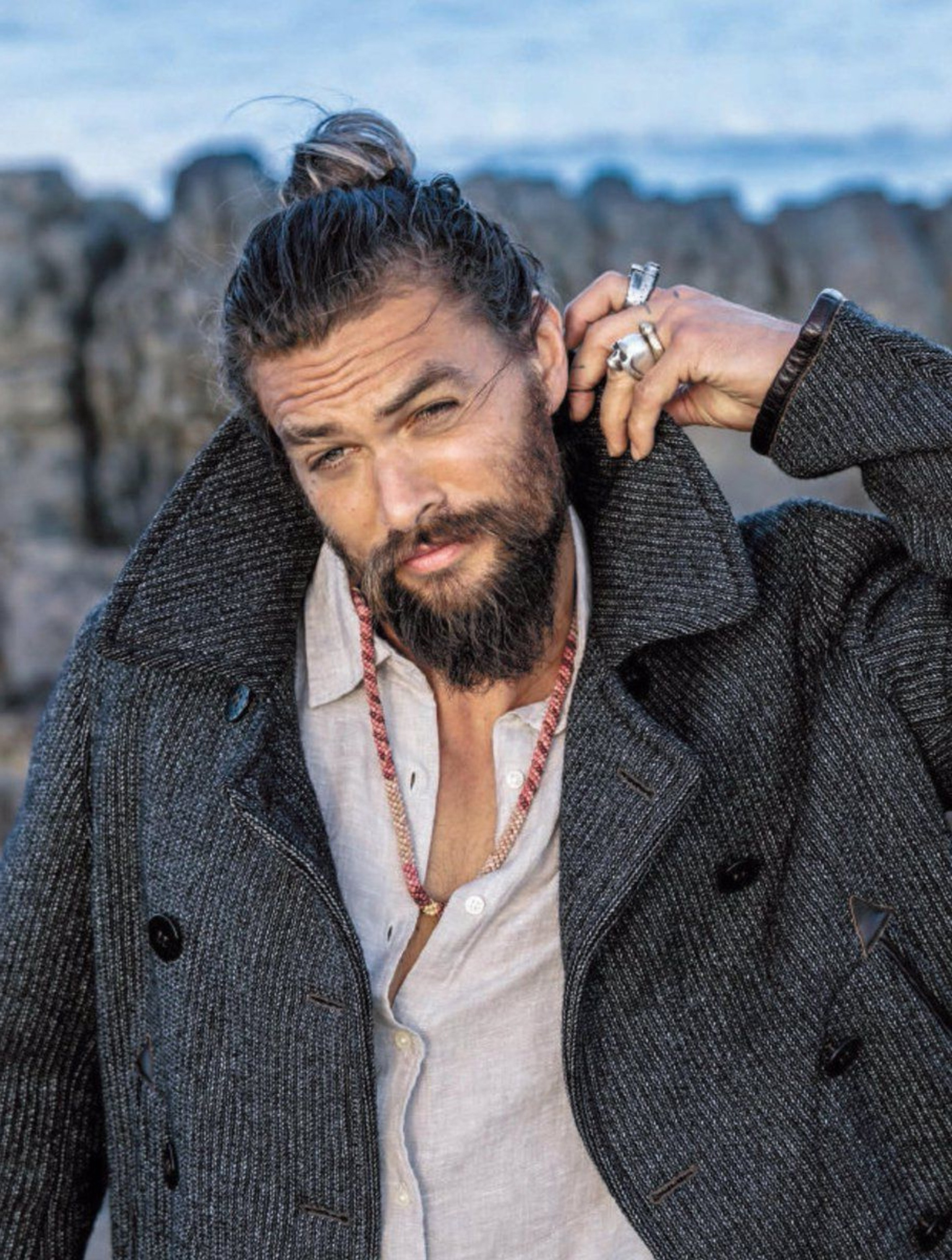 Jason Momoa with a bun hairstyle.
