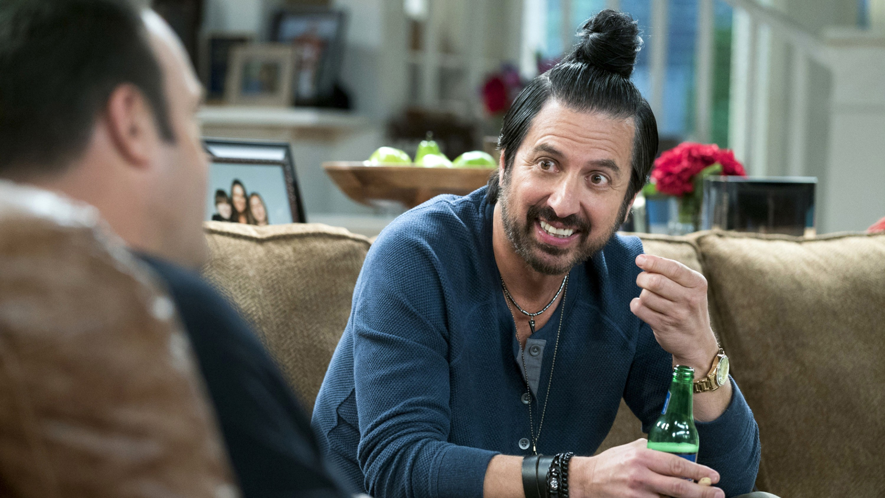 Ray Romano and his super stylish bun hairstyle.