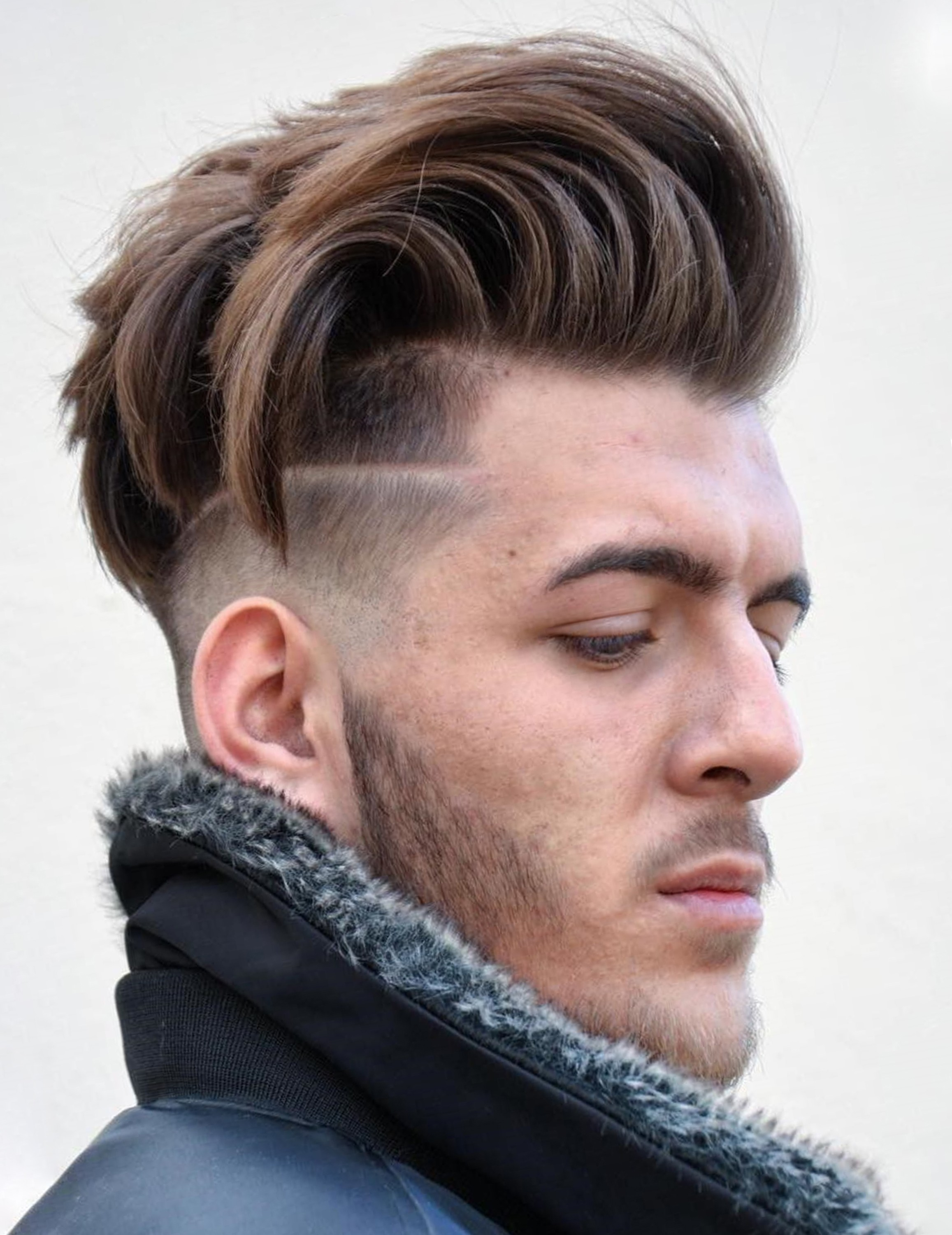 A disconnected undercut haircut for young guys.