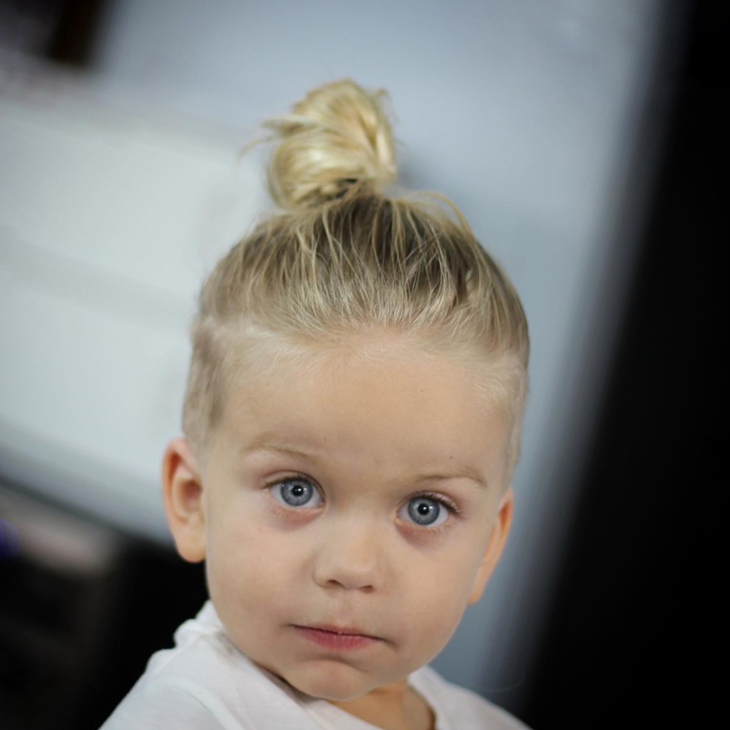 A baby male bun hairstyle.