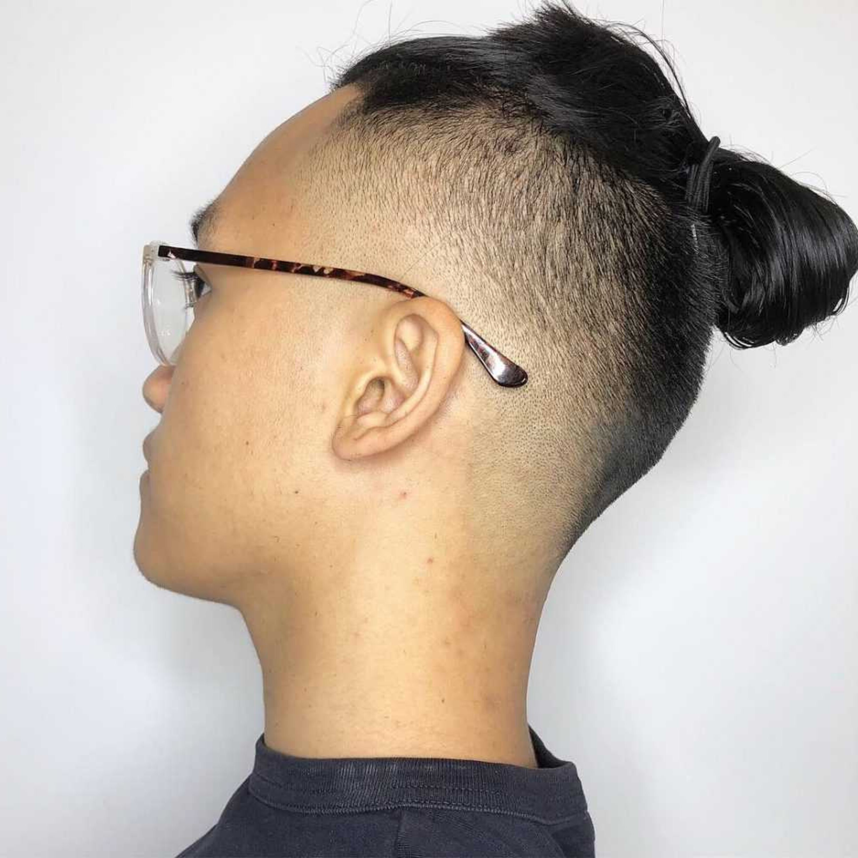 A bun on the almost bald male head.