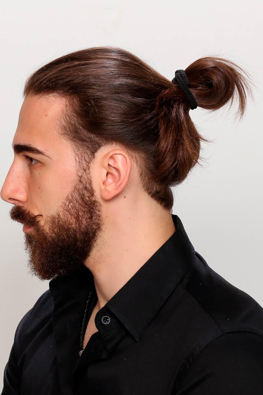 A man bun style for brown hair.