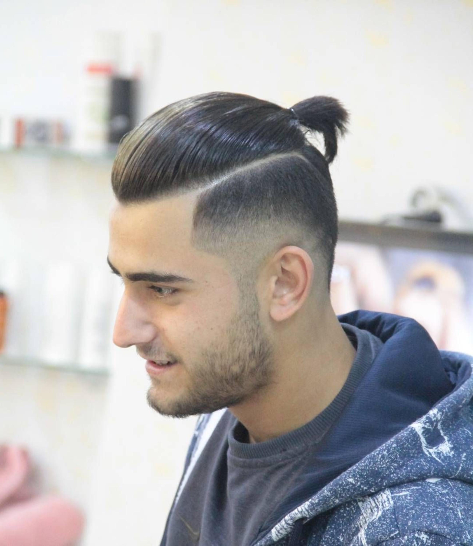 A disconnected bun haircut for men.