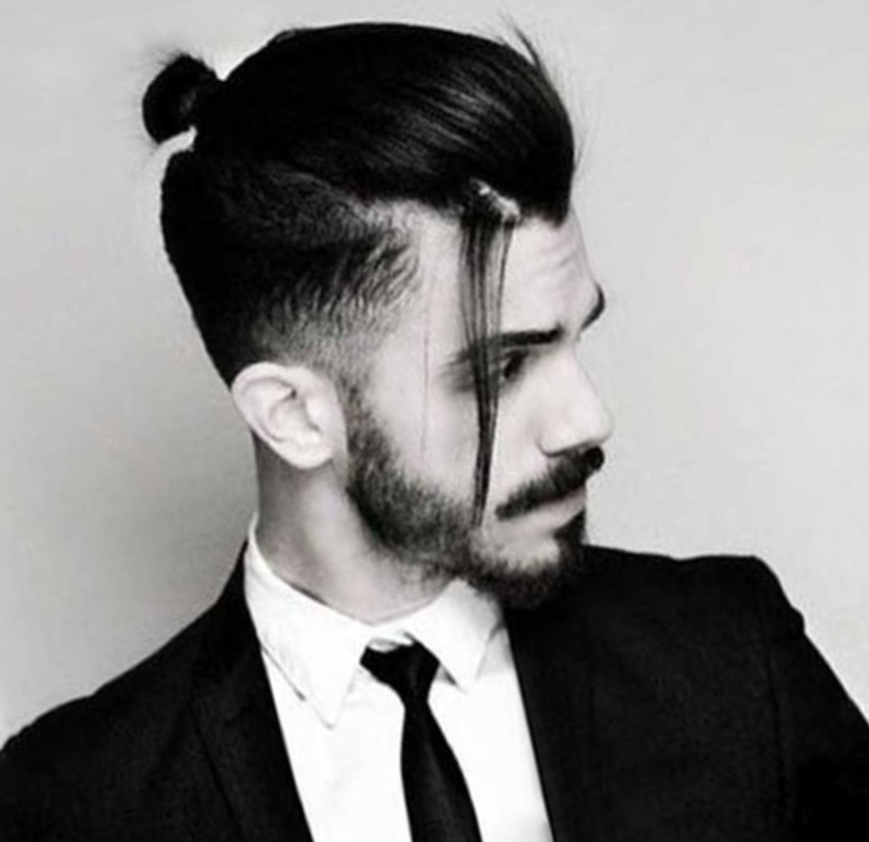A stylish male bun for formal occasions.