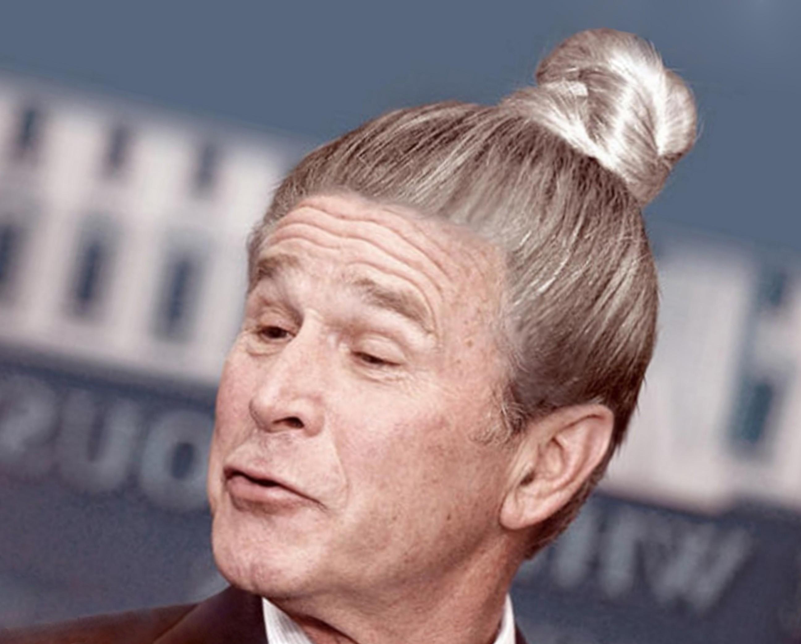 A man with a fun bun style.