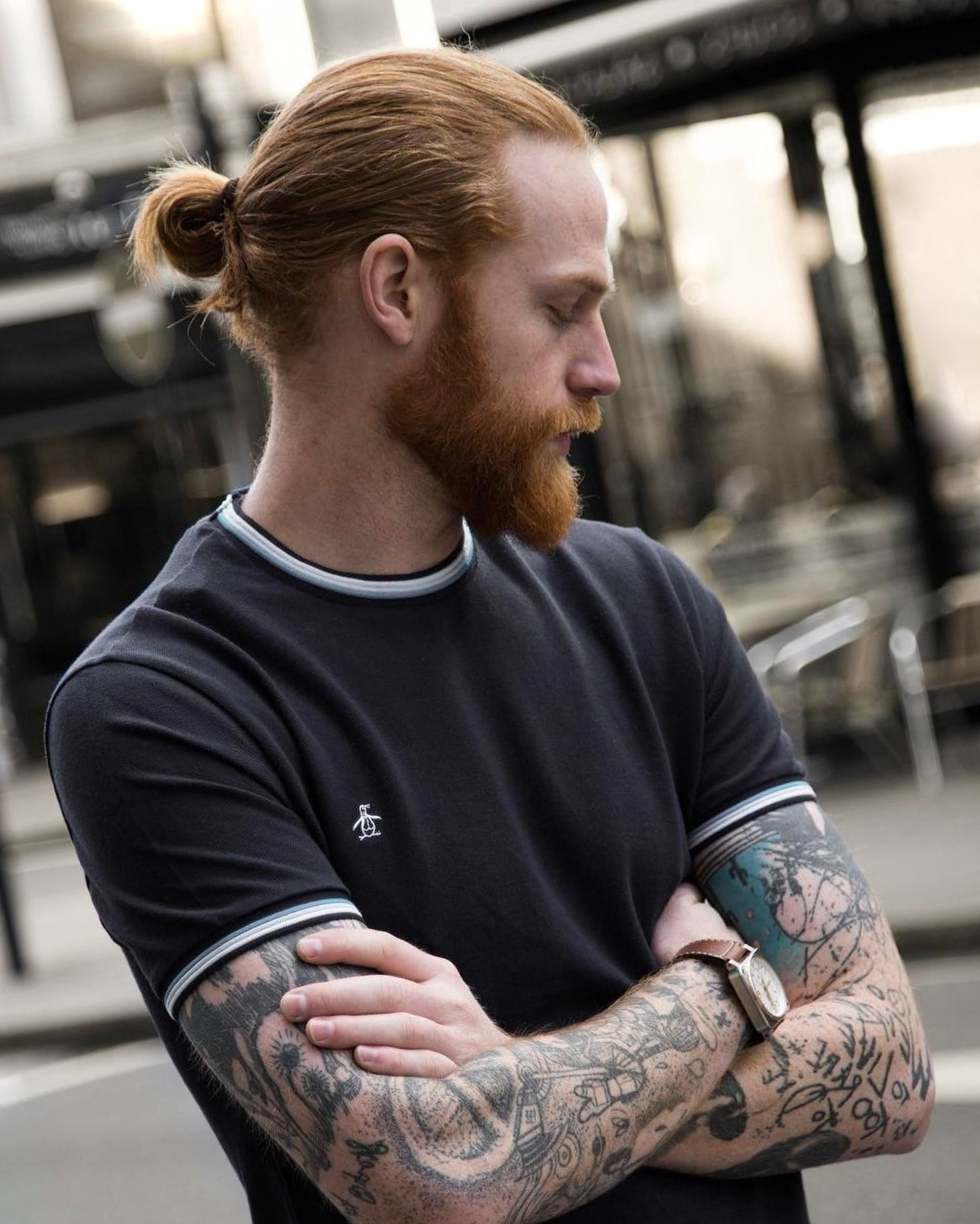 A male bun hairstyle for ginger hair.