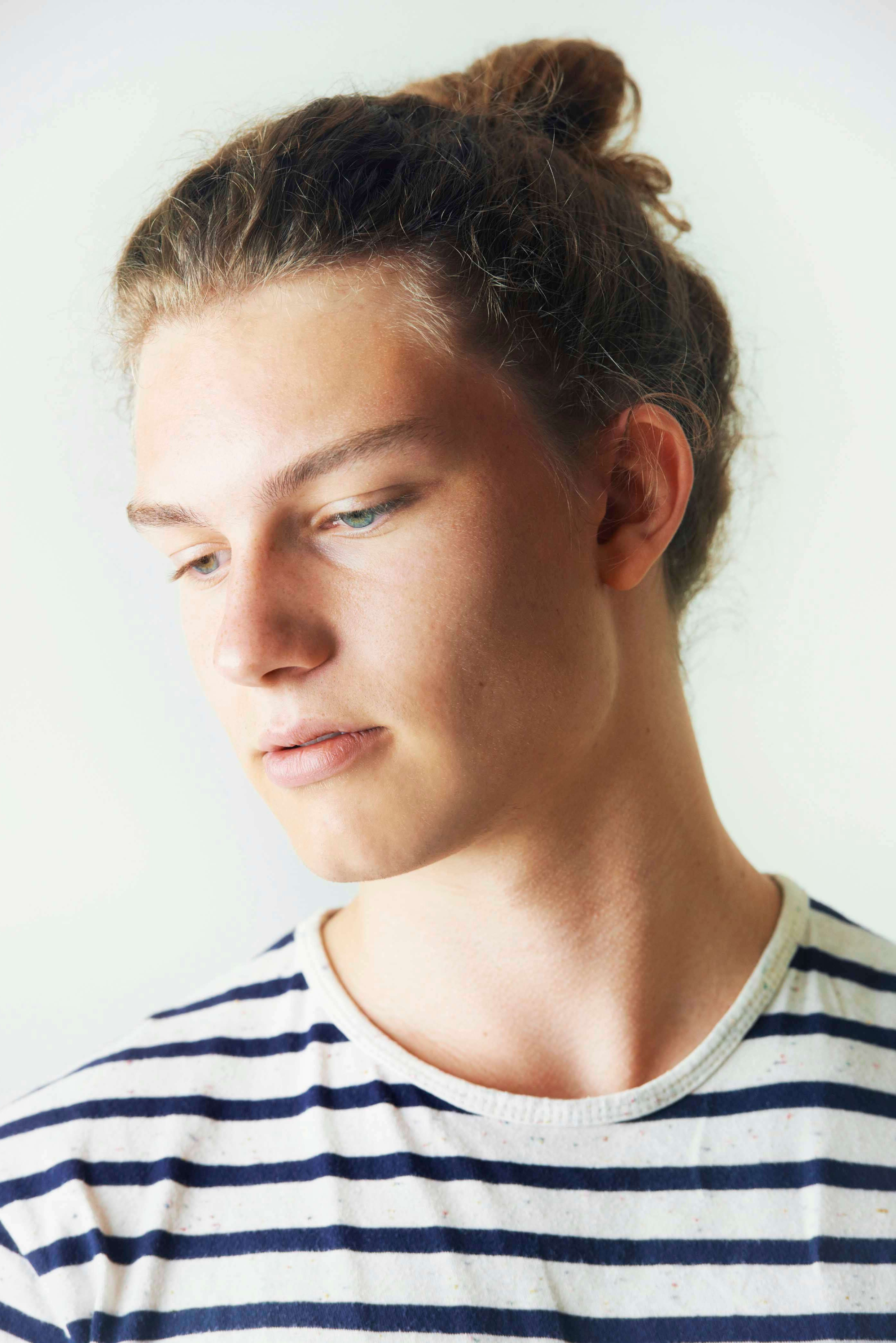 A young guy with a bun.