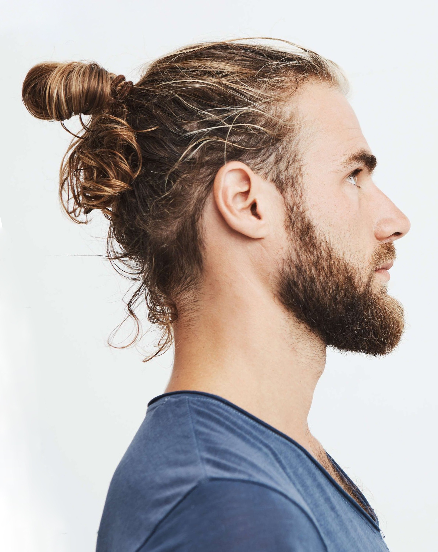 A man with a half bun hairstyle.