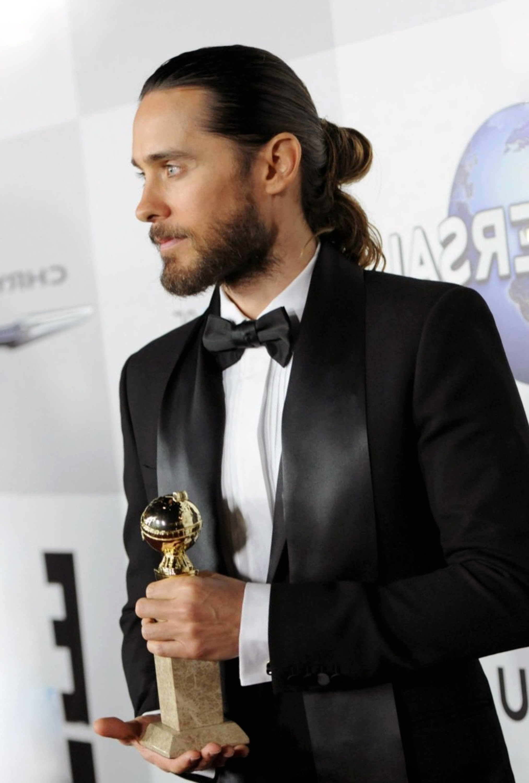 A halfway male bun hairstyle.