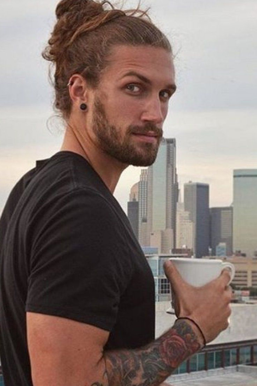 A sexy man with a bun hairstyle.