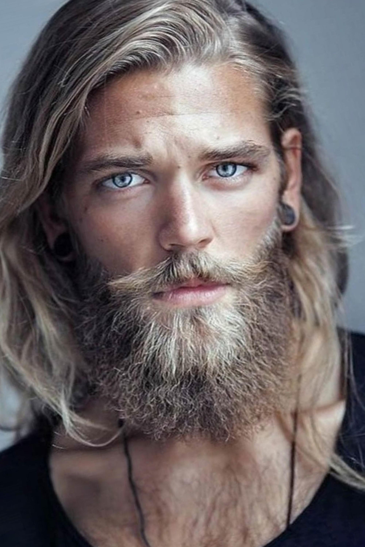 Long Hair men's haircut with Part.