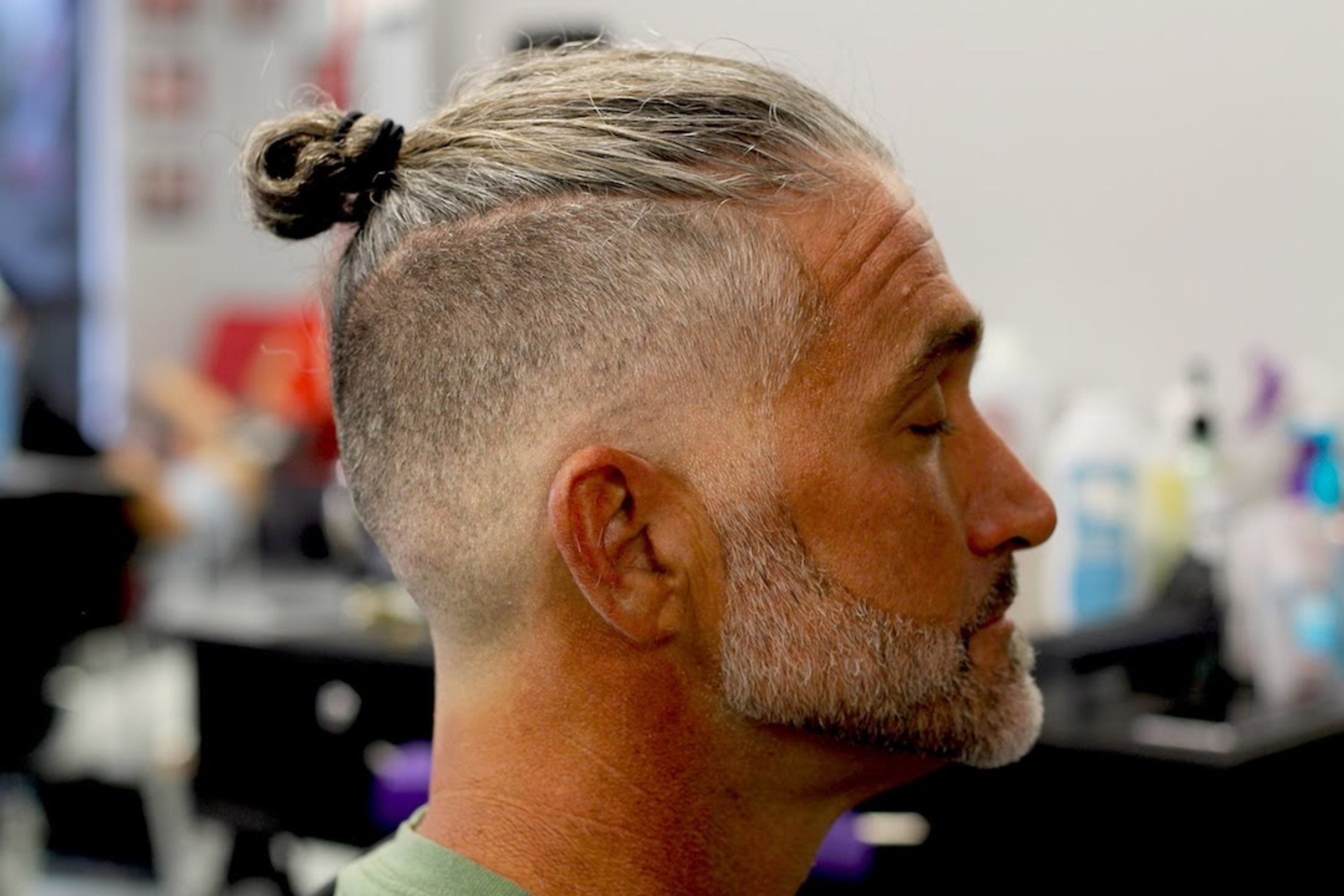 A skin faded haircut with a bun for stylish men.