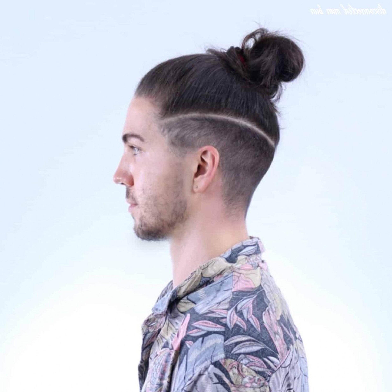A man bun with the undercut haircut.