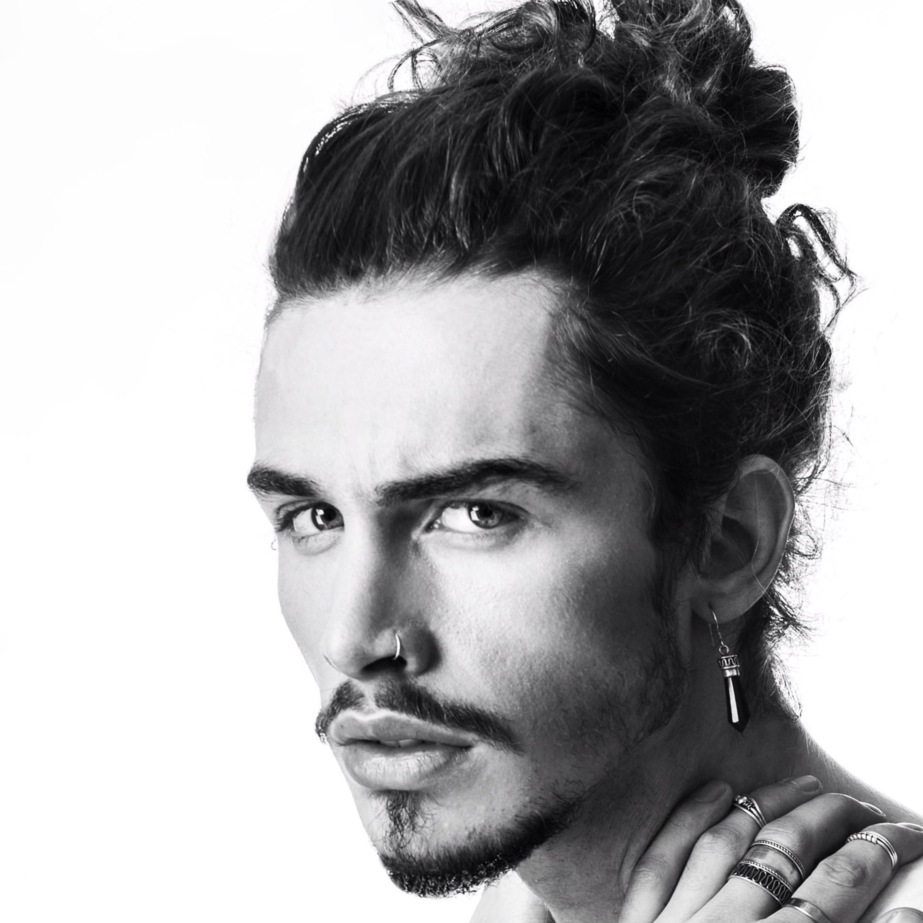 A man with a bun and a Goatee style.