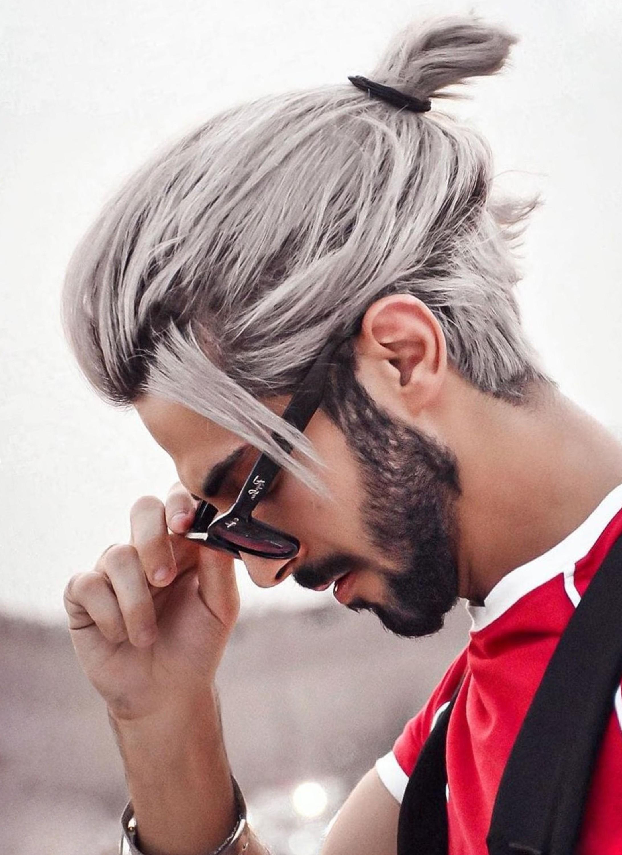 An amazing male bun hairstyle for thin hair.