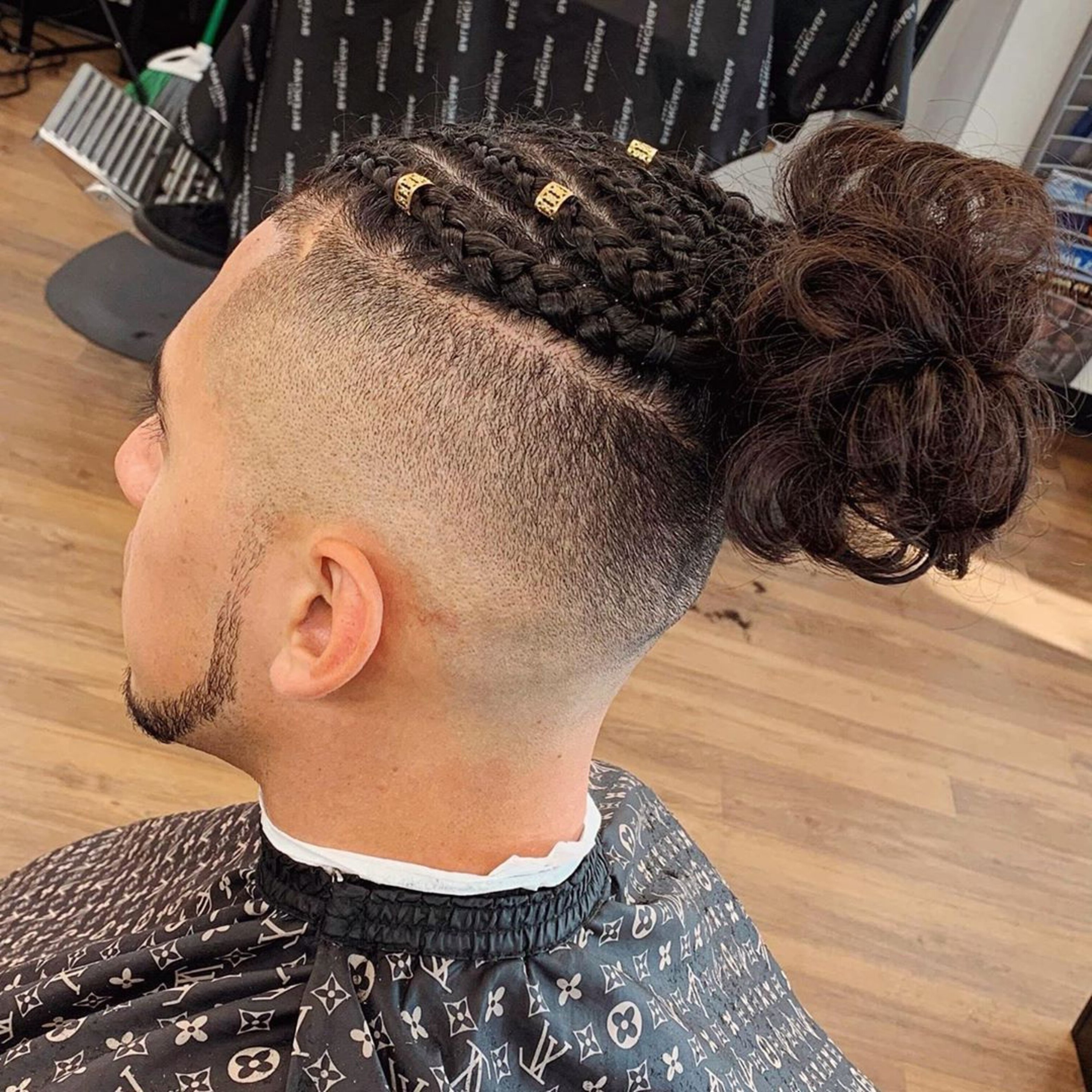 A Puerto Rican male bun hairstyle.