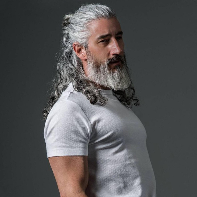 A male bun haircut for silver hair.
