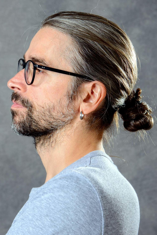 A mini trendy bun for men in 2021.