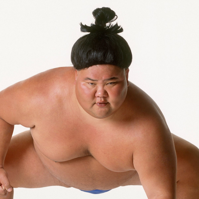 A man bun in the Sumo style.
