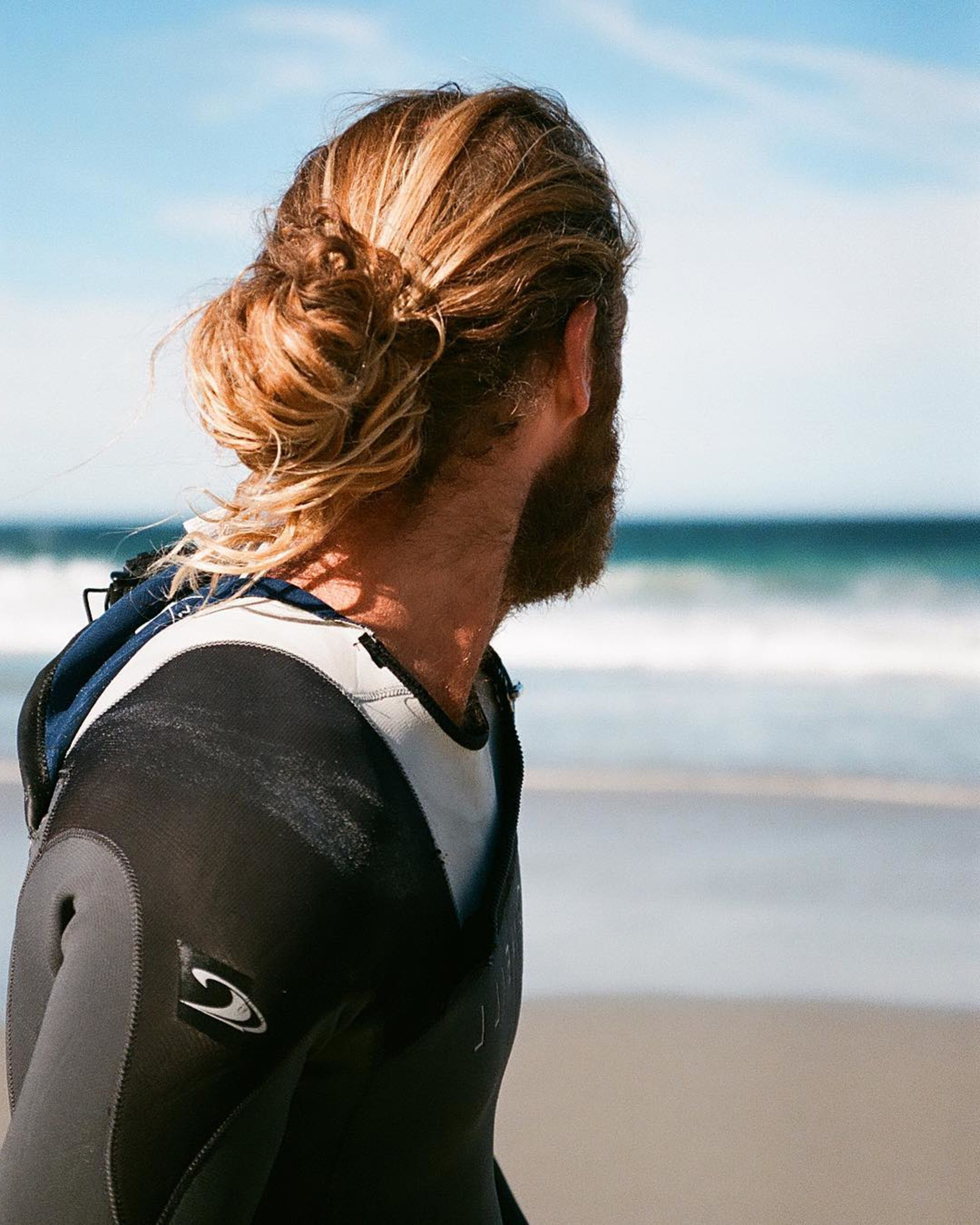 A male bun in the surfer style.